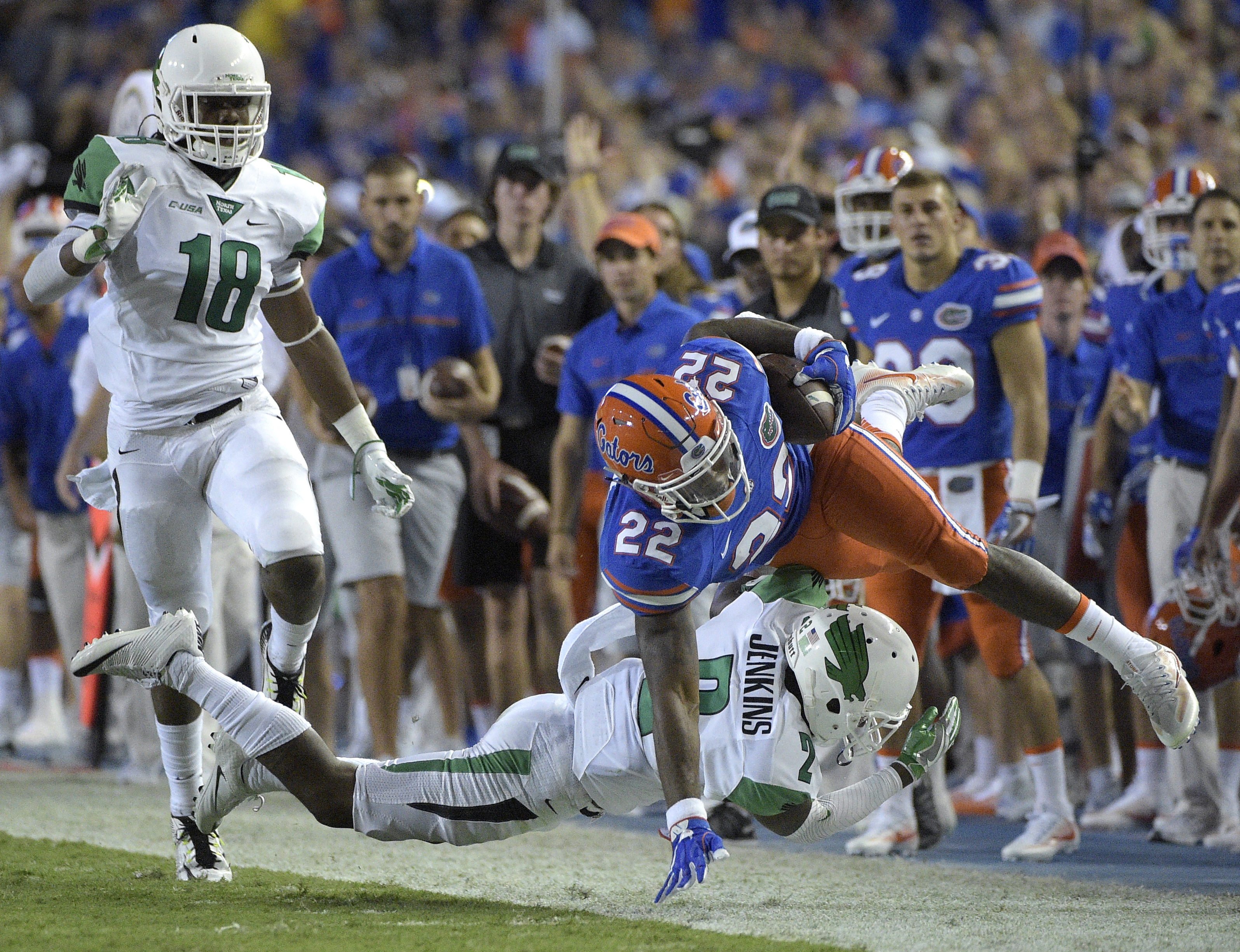 Florida running back Lamical Perine (22) is knocked out of bounds by North Texas defensive back Eric Jenkins (2) after catching a pass for a 29-yard gain during the first half of an NCAA college football game in Gainesville, Fla., Saturday, Sept. 17, 2016