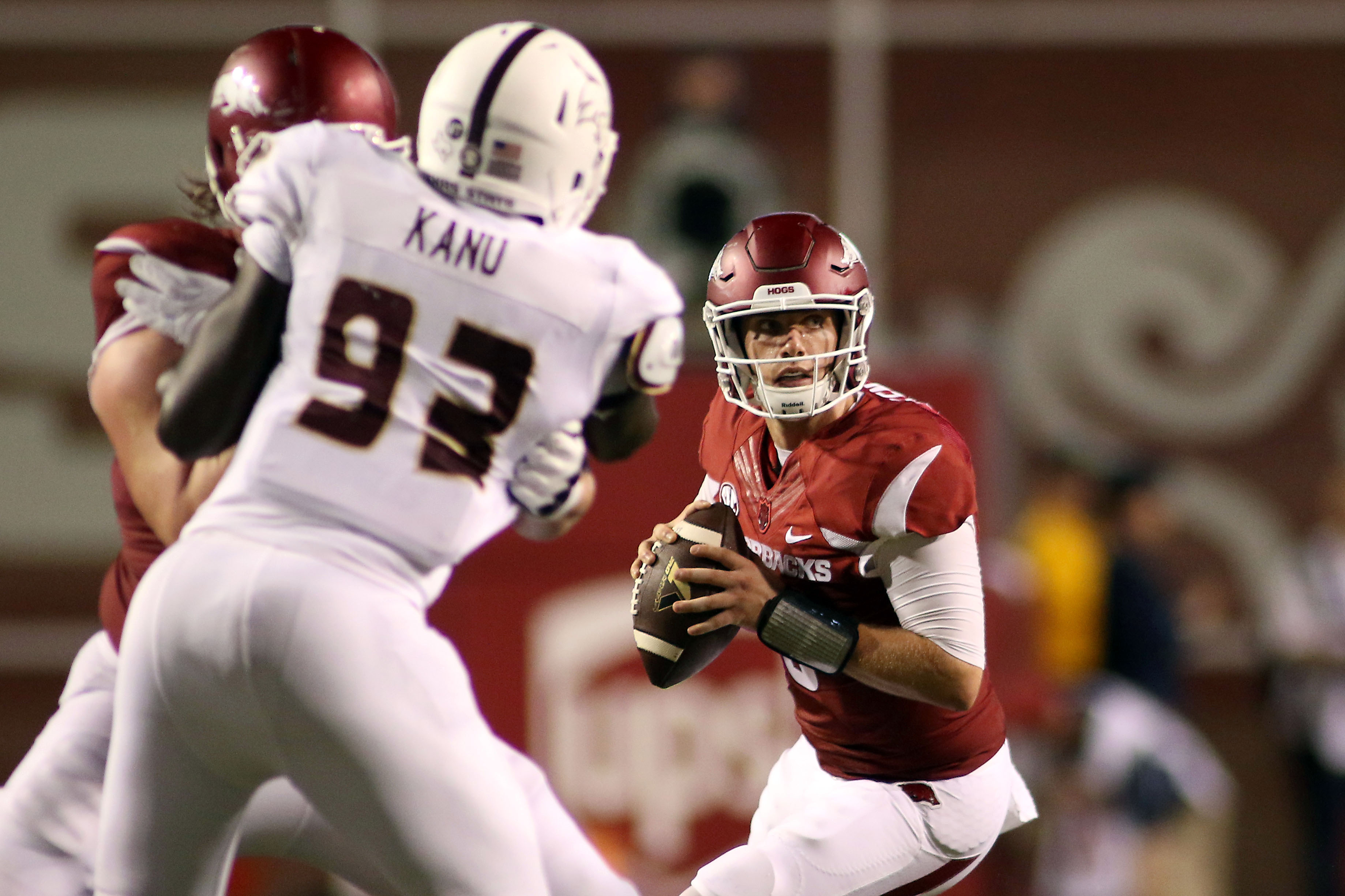Arkansas' Austin Allen, right, looks to pass the ball during the third quarter of an NCAA college football game against Texas State Saturday, Sept. 17, 2016 in Fayetteville, Ark. Arkansas beat Texas State, 42-3.(AP Photo/Samantha Baker)