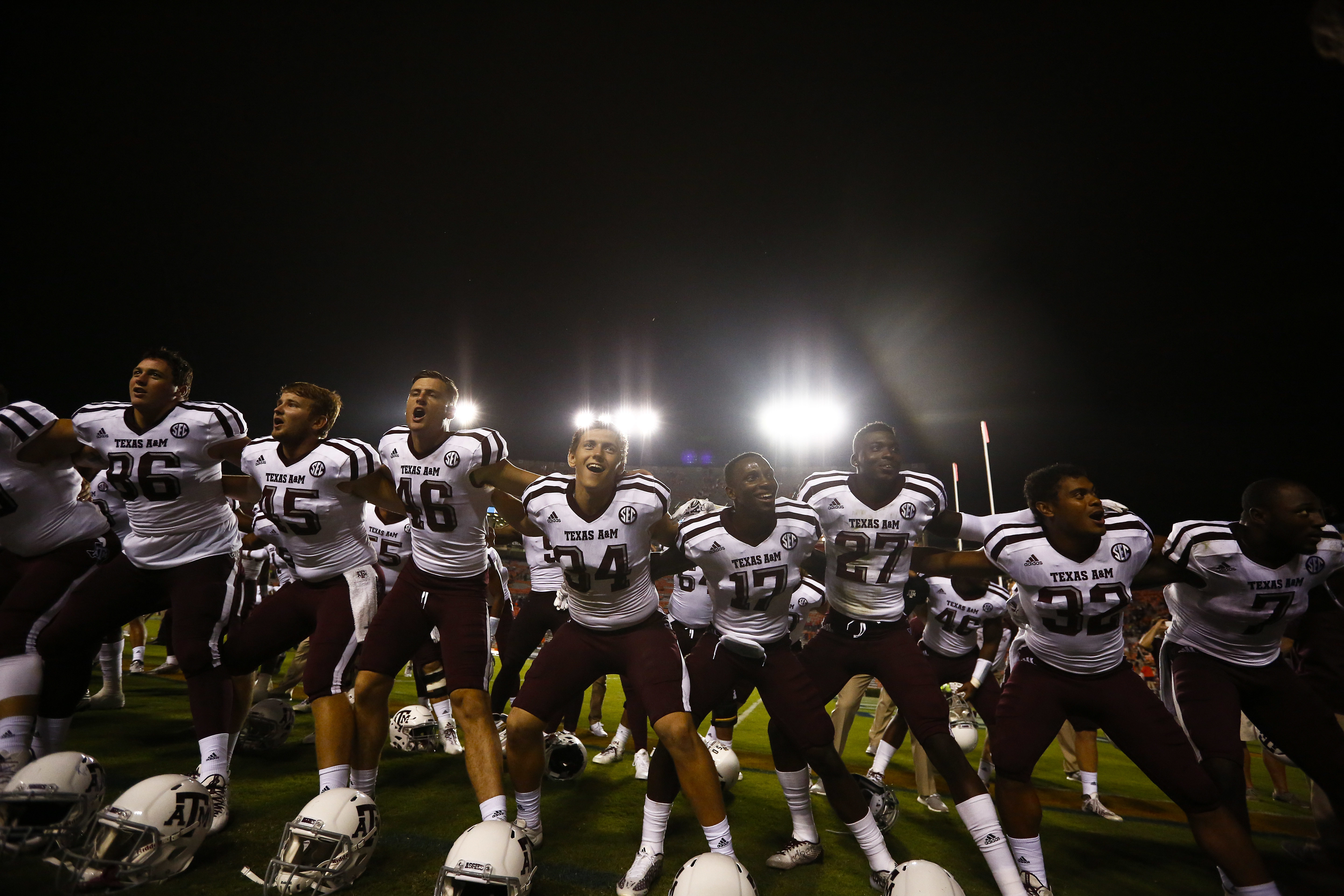 Texas A&M players sing and celebrate after defeating Auburn in an NCAA college football game, Saturday, Sept. 17, 2016, in Auburn, Ala. (AP Photo/Brynn Anderson)