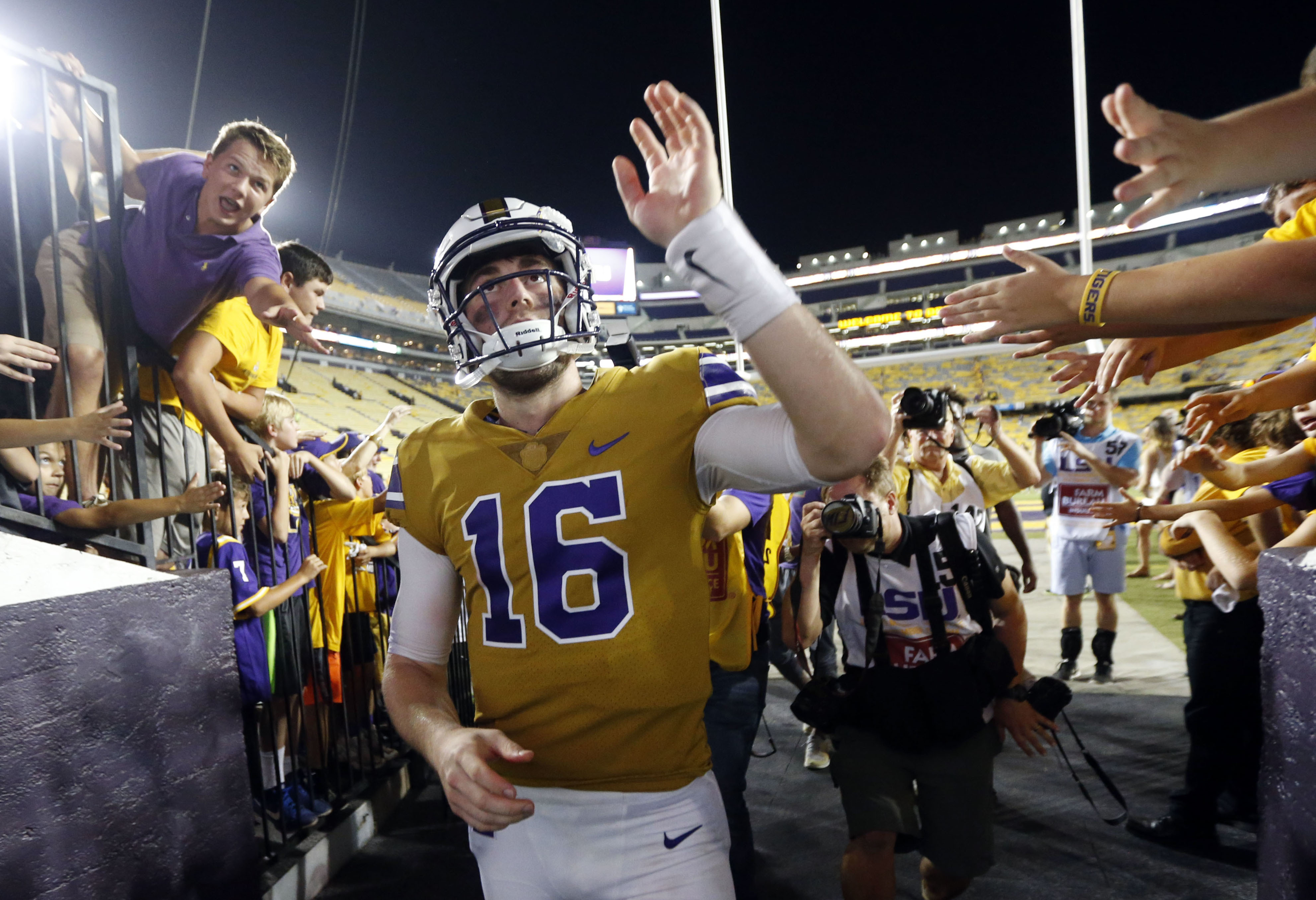 LSU quarterback Danny Etling (16) greets fans after an NCAA college football game against Mississippi Statein Baton Rouge, La., Saturday, Sept. 17, 2016. LSU win 23-20. (AP Photo/Gerald Herbert)