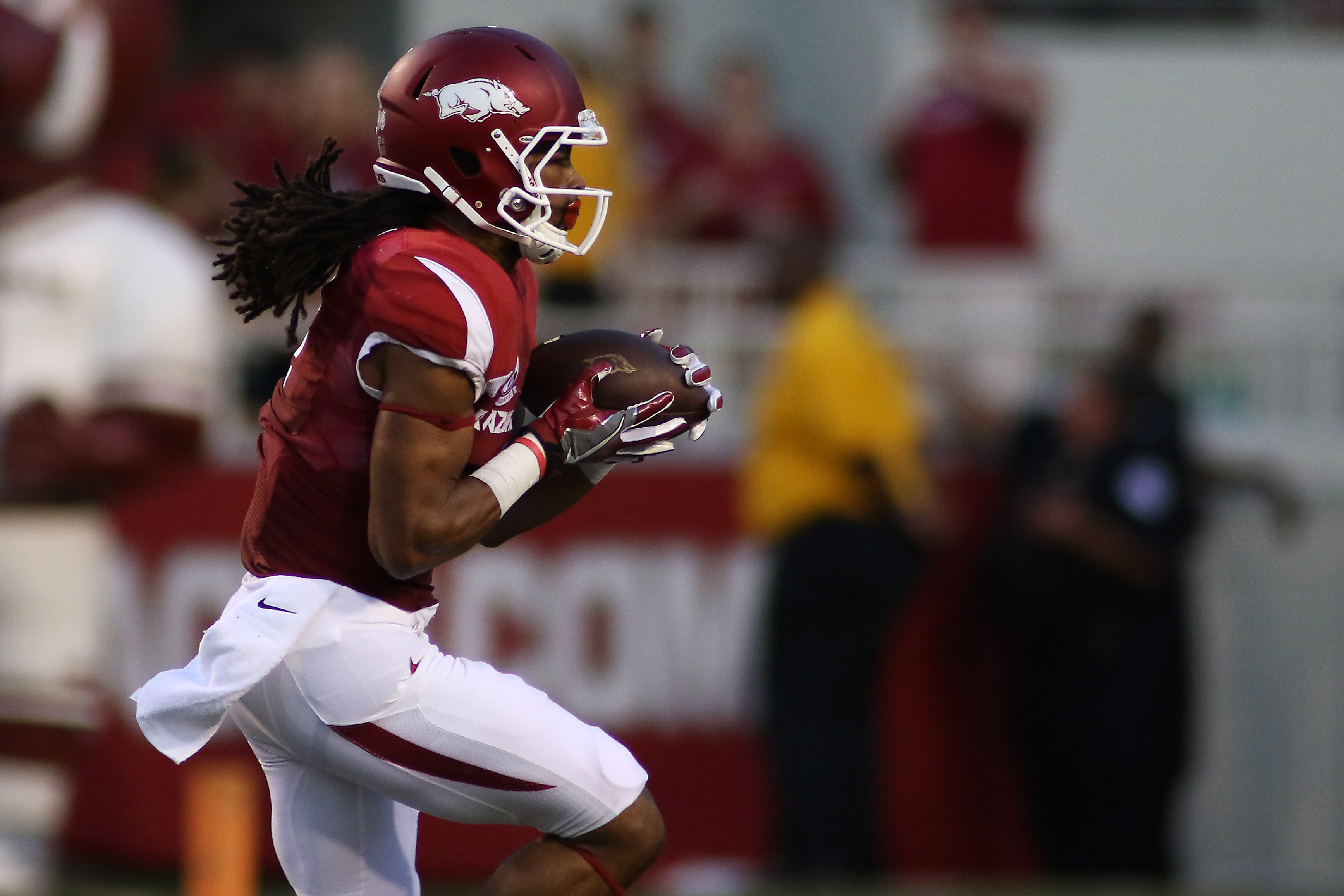 Arkansas' Keon Hatcher catches a pass for a long game yard during an NCAA college football game against Texas State on Saturday, Sept. 17, 2016, in Fayetteville, Ark. Arkansas won 42-3. (AP Photo/Samantha Baker)