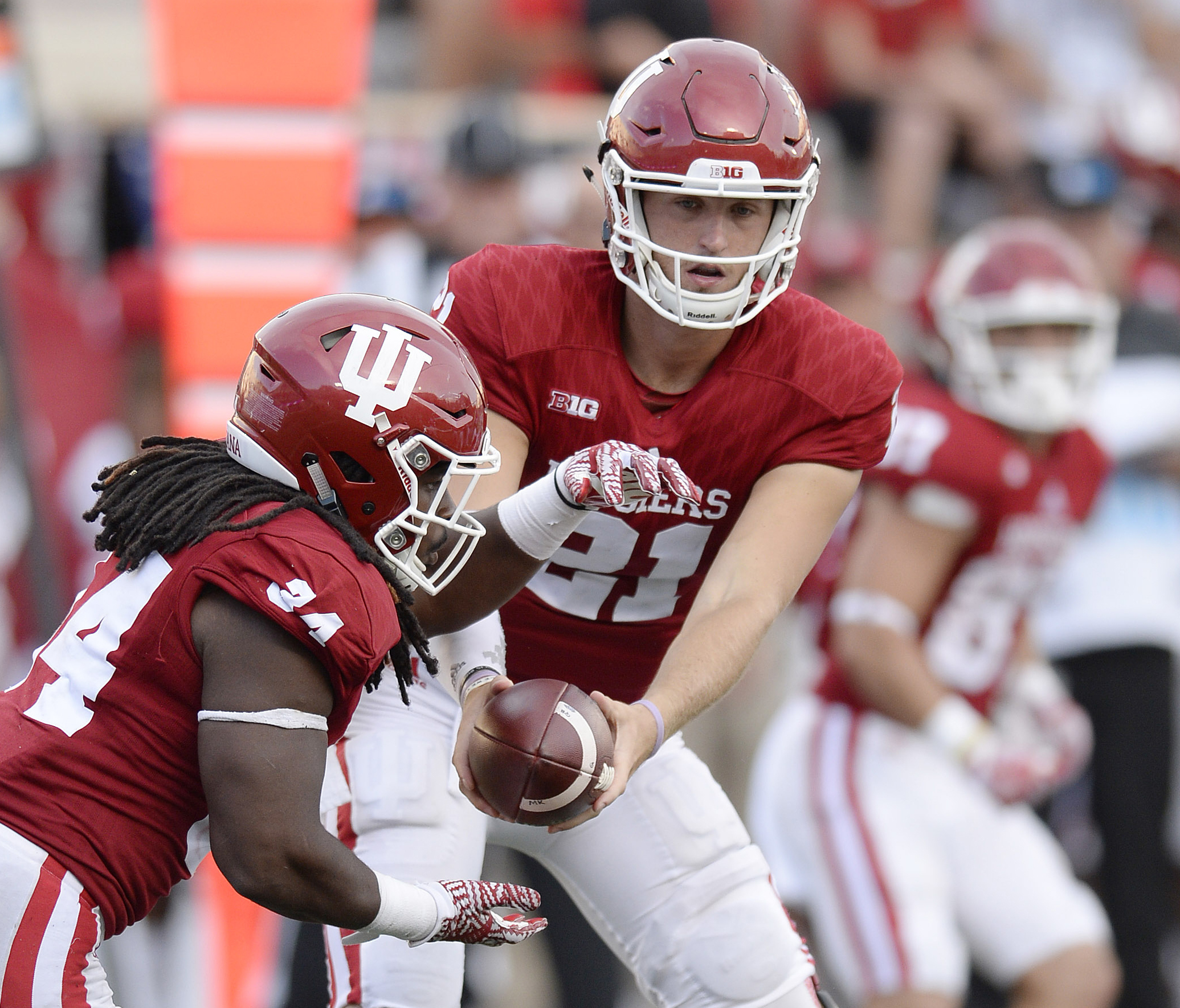 FILE - In this Sept. 10, 2016, file photo, Indiana quarterback Richard Lagow (21) hands off to running back Devine Redding (34) during during the team's NCAA college football game against Ball State, in Bloomington, Ind. Lagow likes everything about his n