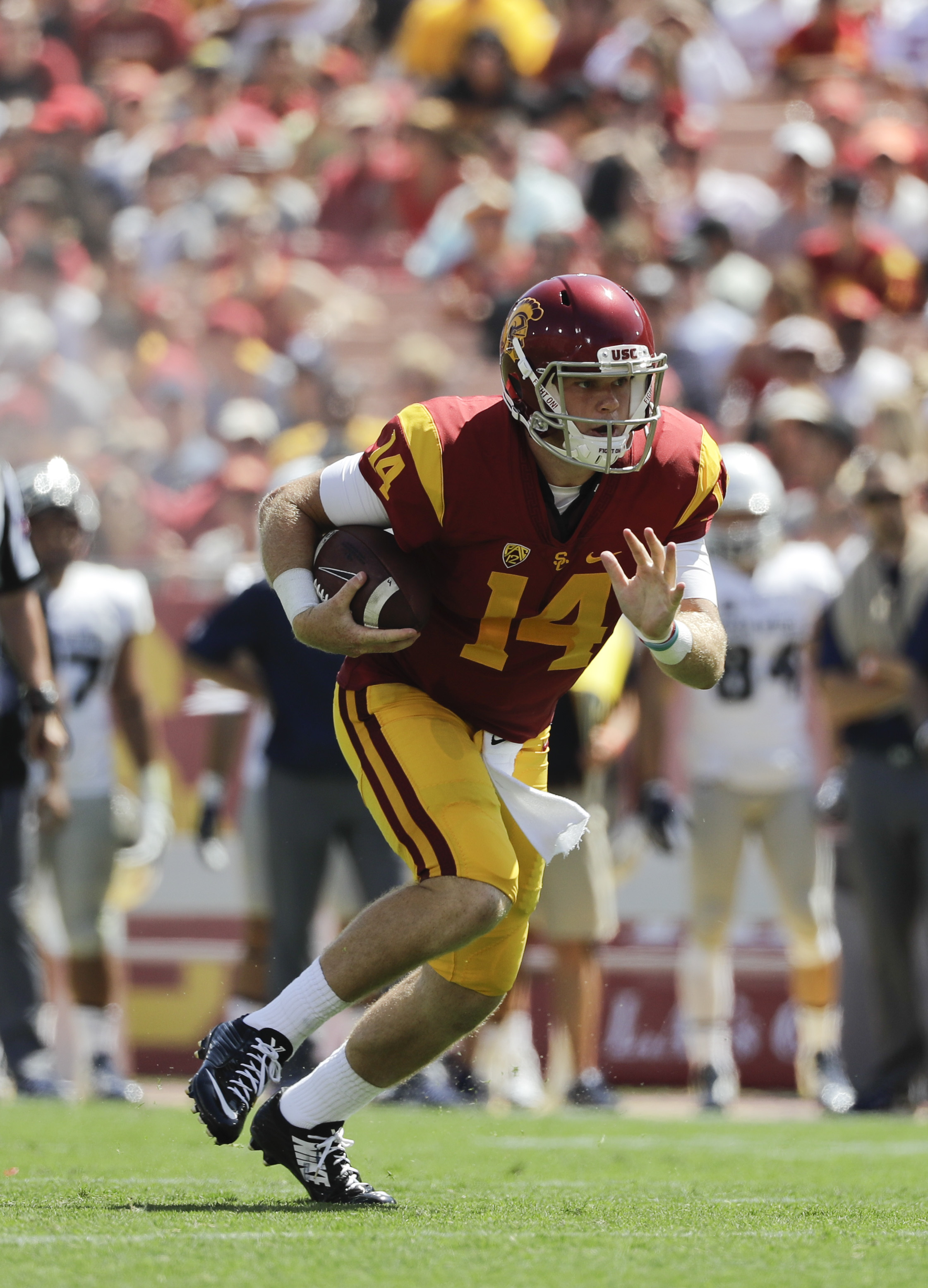 In this Saturday, Sept. 10, 2016, photo, Southern California quarterback Sam Darnold carries the ball during the second half of an NCAA college football game against Utah State in Los Angeles. Freshman Sam Darnold will be Southern Californias starting qua
