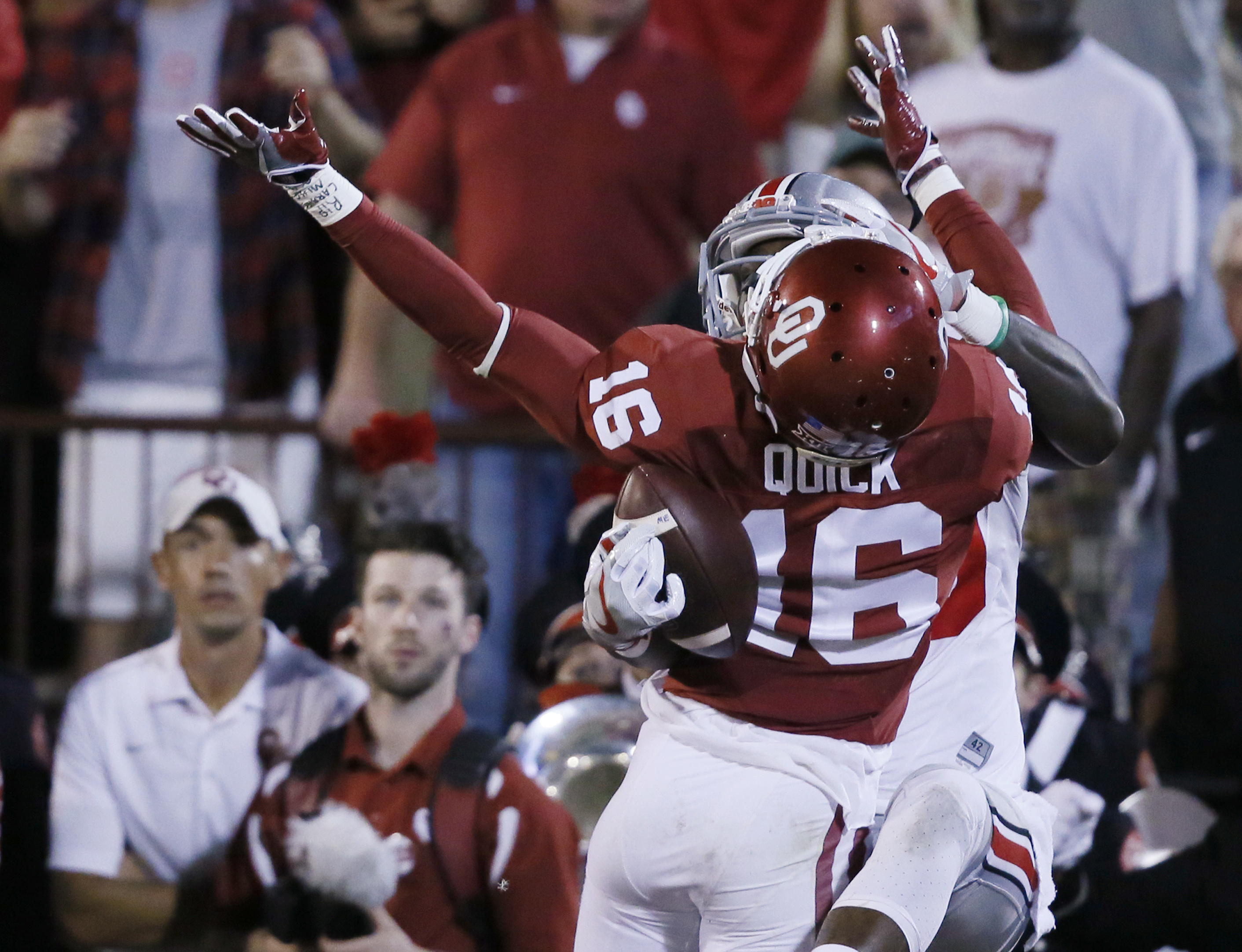 FILE - In this Sept. 17, 2016, file photo, Ohio State wide receiver Noah Brown, rear, grabs a pass for a touchdown on the back of Oklahoma defender Michiah Quick (16) during the second quarter of an NCAA college football game in Norman, Okla. The Ohio Sta