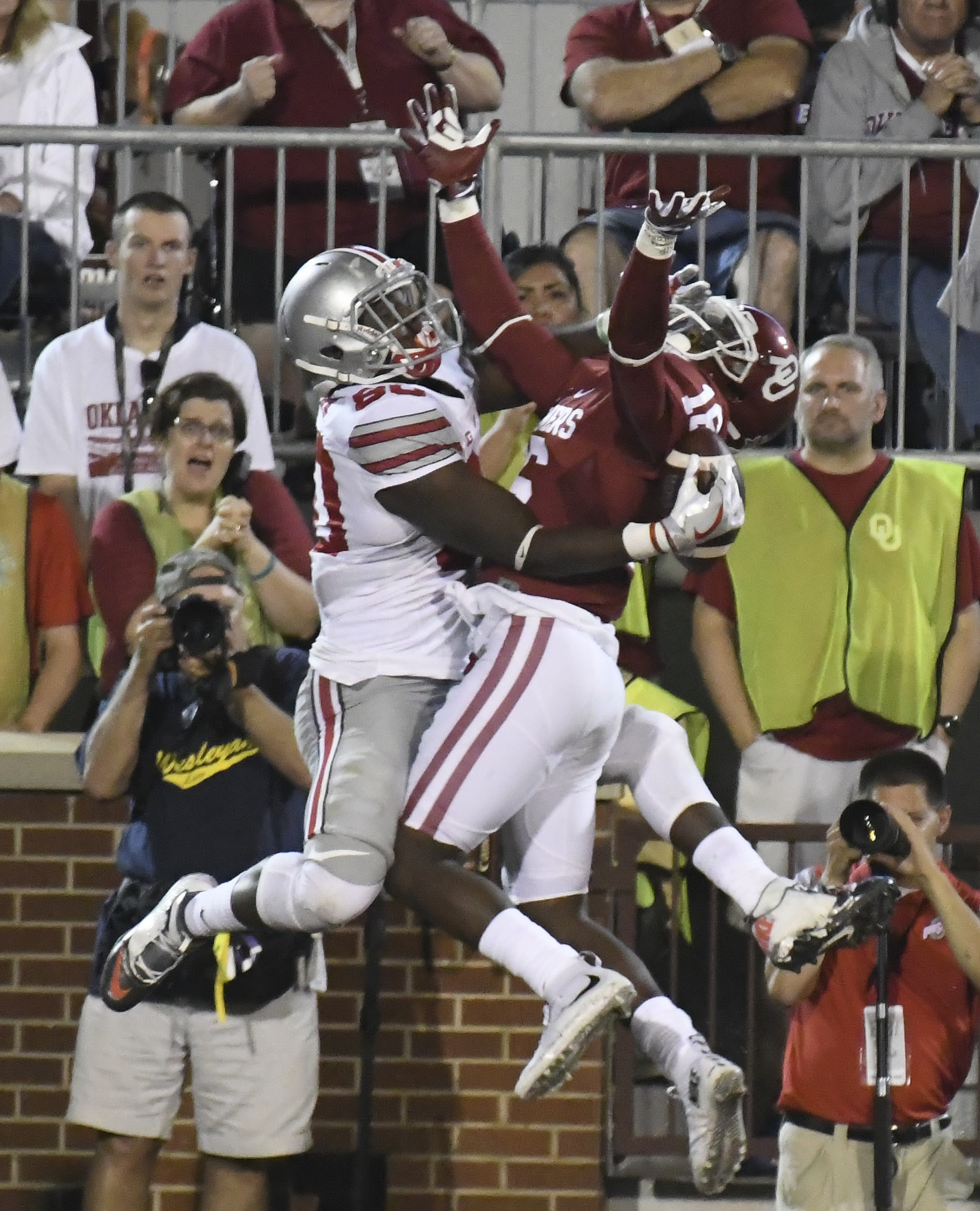 FILE - In this Sept. 17, 2016, file photo, Ohio State's Noah Brown catches a touchdown pass on the back of Oklahoma's Michiah Quick during the second quarter of an NCAA college football game in Norman, Okla. The Ohio State Buckeyes are exactly where they
