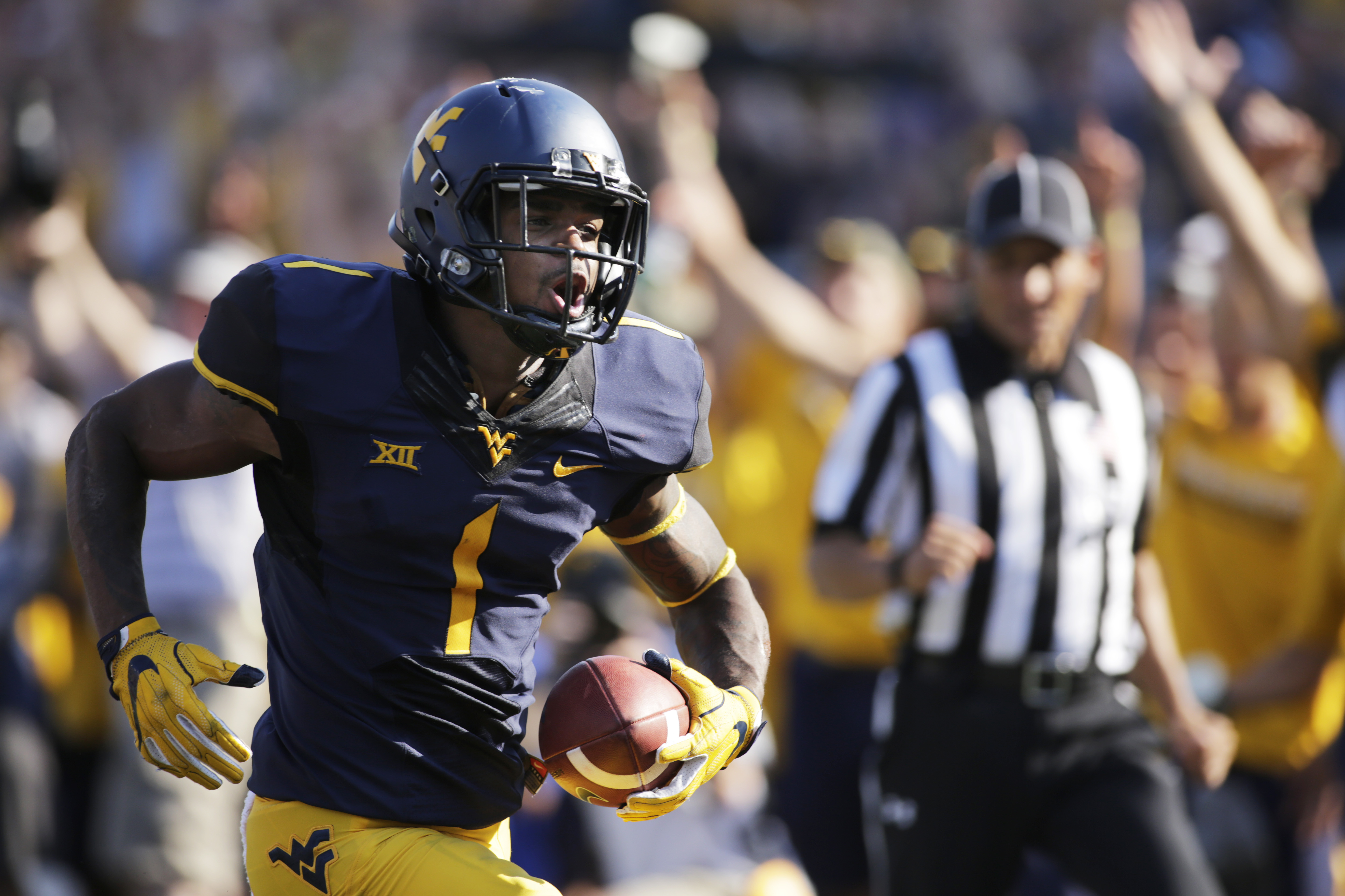 FILE - In this Sept. 10, 2016, file photo, West Virginia wide receiver Shelton Gibson (1) runs for a touchdown after a catch during the first half of an NCAA college football game against Youngstown State, in Morgantown, W.Va. A year ago West Virginia rec