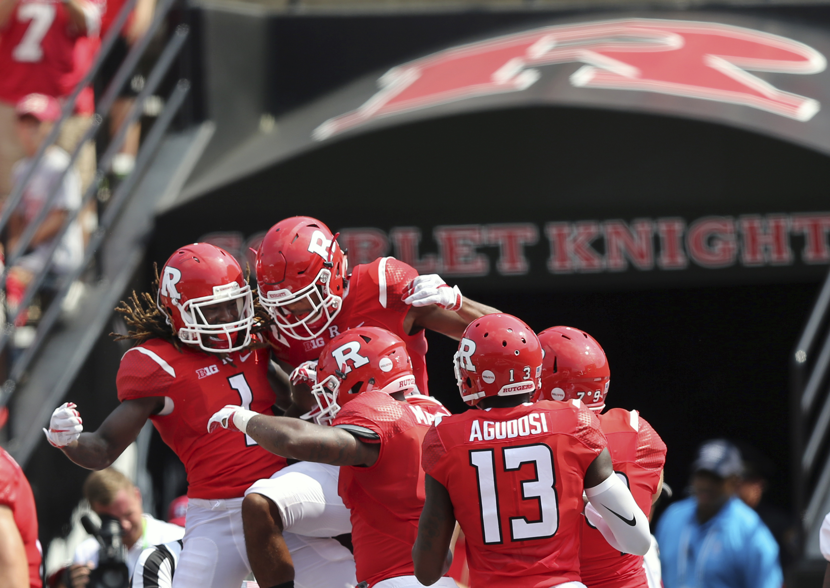 In this Saturday, Sept. 10, 2016, photograph, Rutgers wide receiver Janarion Grant, left, wide receiver Andre Patton, second left, and running back Robert Martin, center, along with wide receiver Carlton Agudosi, right, and others celebrate a touchdown du