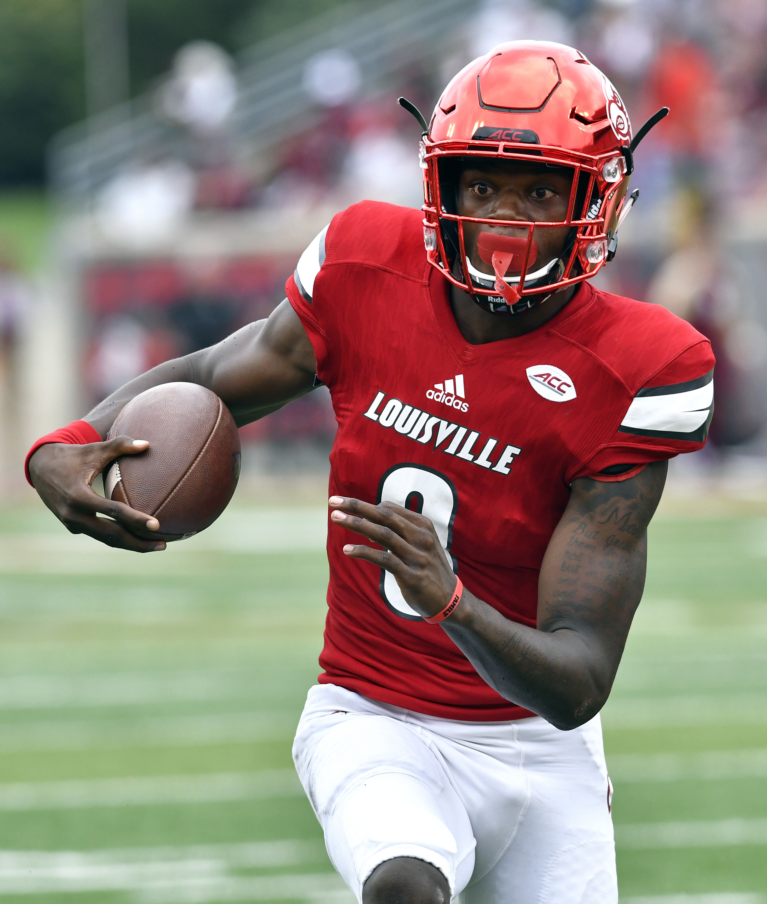 FILE - In this Sept. 17, 2016, file photo, Louisville's Lamar Jackson runs through an opening in the Florida State line during the first quarter of an NCAA college football game, in Louisville Ky. Lamar Jackson and No. 3 Louisville go from playing the mai