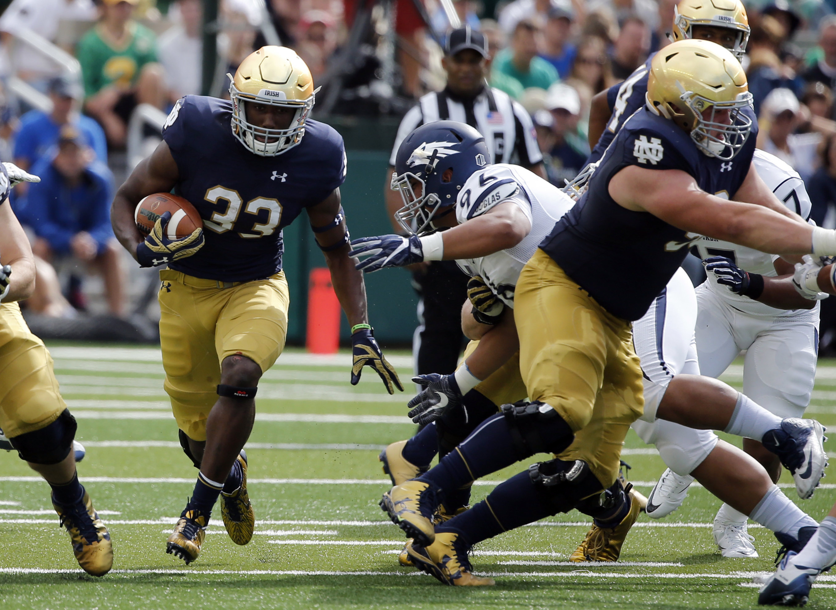FILE - In this Saturday, Sept. 10, 2016, file photo, Notre Dame running back Josh Adams (33) carries the ball during the first half of an NCAA college football game against Nevada in South Bend, Ind. Adams has tried to help set the tone for the Fighting I