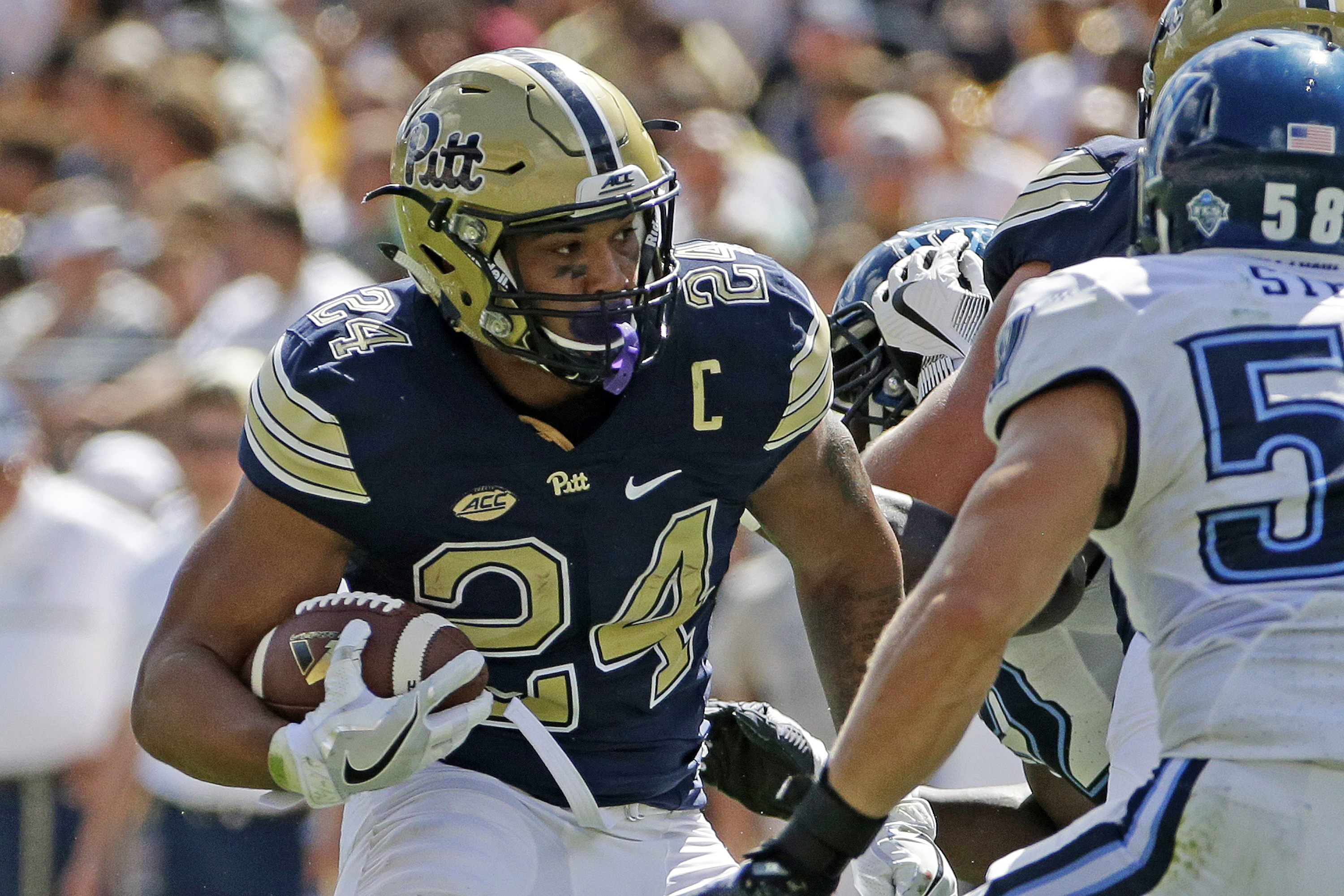 File-This Sept. 3, 2016, file photo shows Pittsburgh running back James Conner (24) making a cut in front of Villanova linebacker Jeff Streib (58) during the first half of an NCAA college football game in Pittsburgh.   Conner has run for two straight 100-