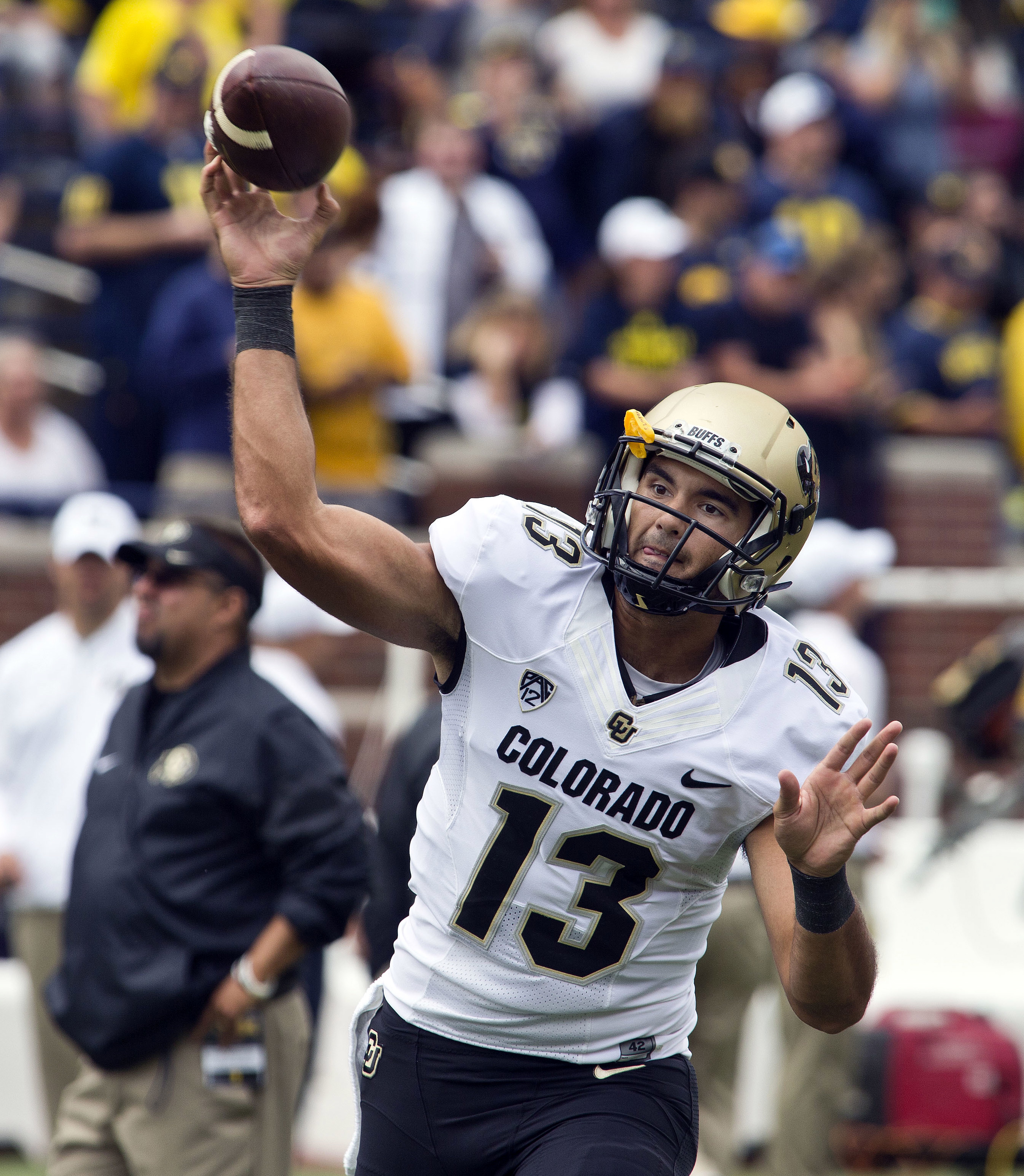 FILE - In this Sept. 17, 2016, file photo, Colorado quarterback Sefo Liufau warmups before an NCAA college football game against Michigan at Michigan Stadium in Ann Arbor, Mich. Oregon hosts Colorado on Saturday.  (AP Photo/Tony Ding, File)