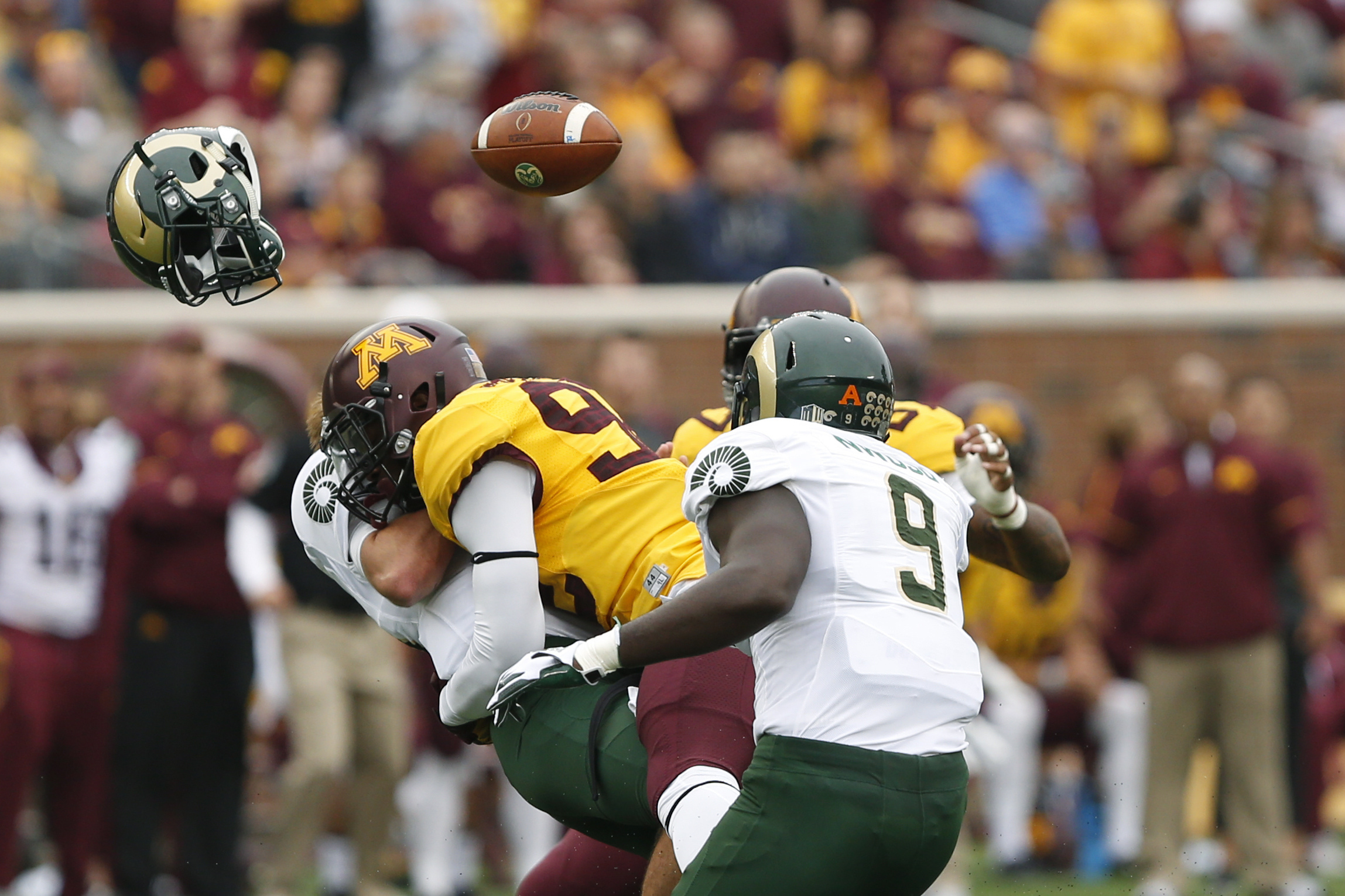 Colorado State quarterback Collin Hill loses his helmet and football after being tackled by Minnesota defensive lineman Tai'yon Devers during an NCAA college football game Saturday, Sept. 24, 2016, in Minneapolis. (AP Photo/Stacy Bengs)