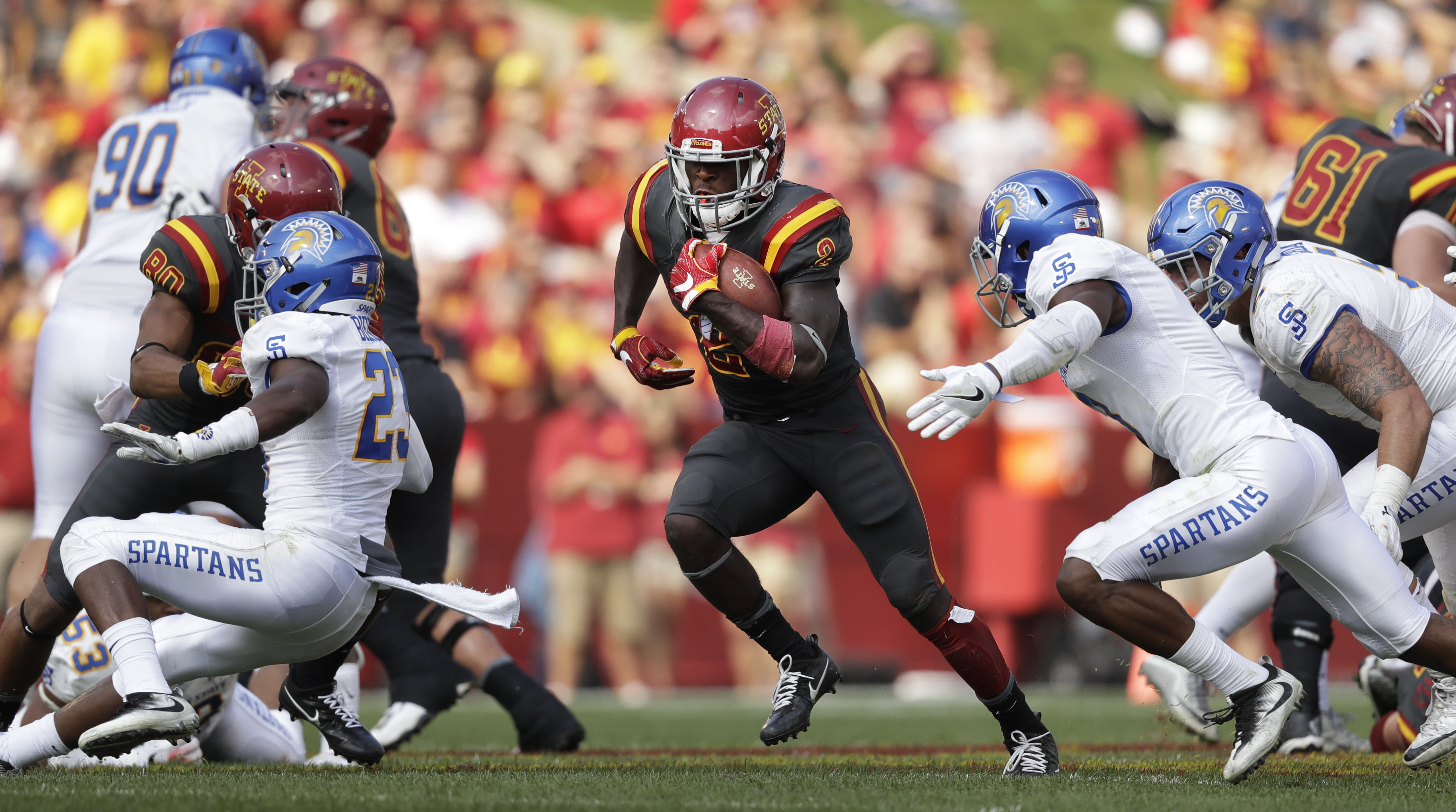 Iowa State running back Mike Warren (2) runs up field during the second half of an NCAA college football game against San Jose State, Saturday, Sept. 24, 2016, in Ames, Iowa. Iowa State won 44-10. (AP Photo/Charlie Neibergall)