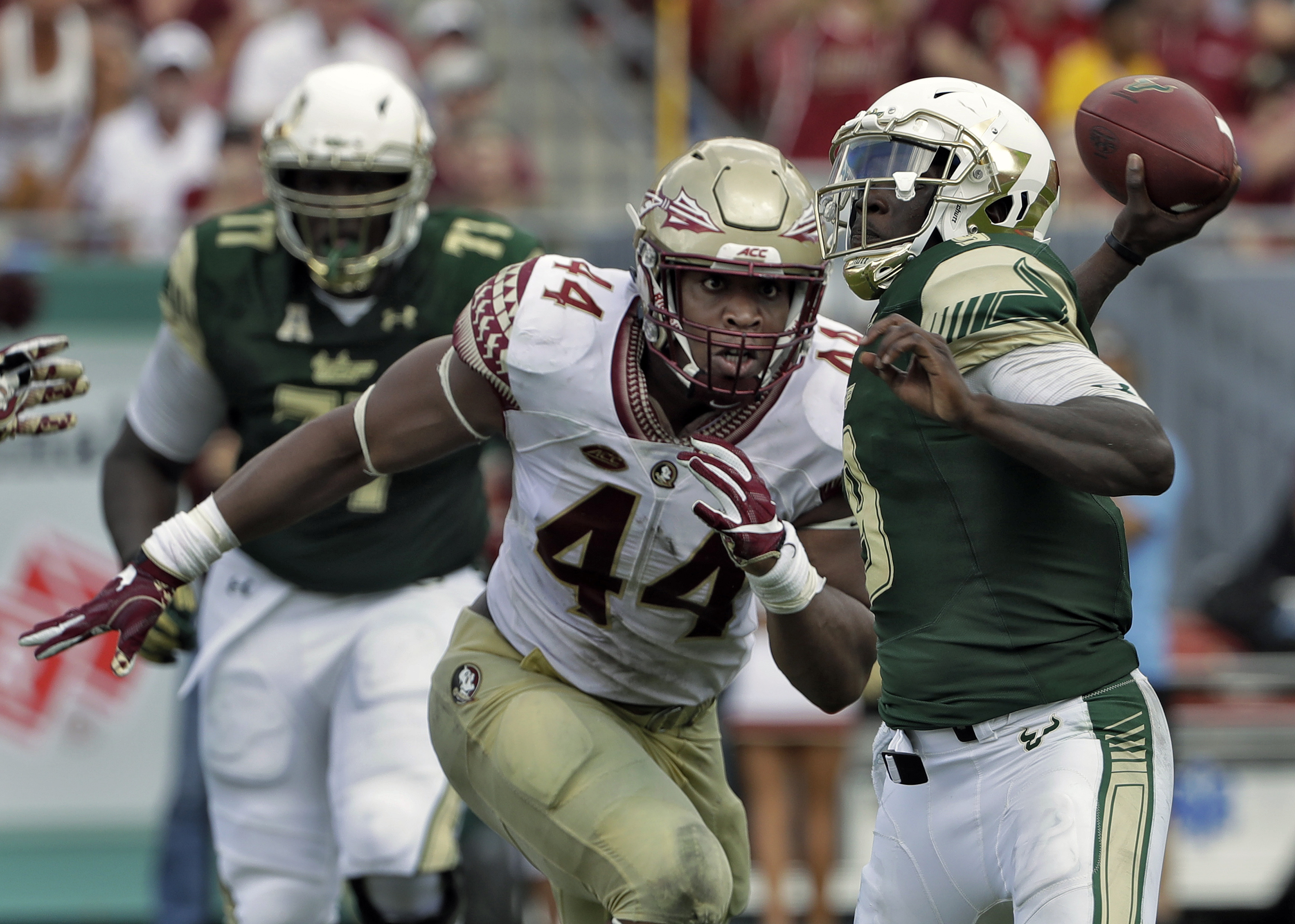 Florida State defensive end DeMarcus Walker (44) closes in on South Florida quarterback Quinton Flowers as he throws a pass during the second half of an NCAA college football game, Saturday, Sept. 24, 2016, in Tampa, Fla. Florida State won the game 55-35.