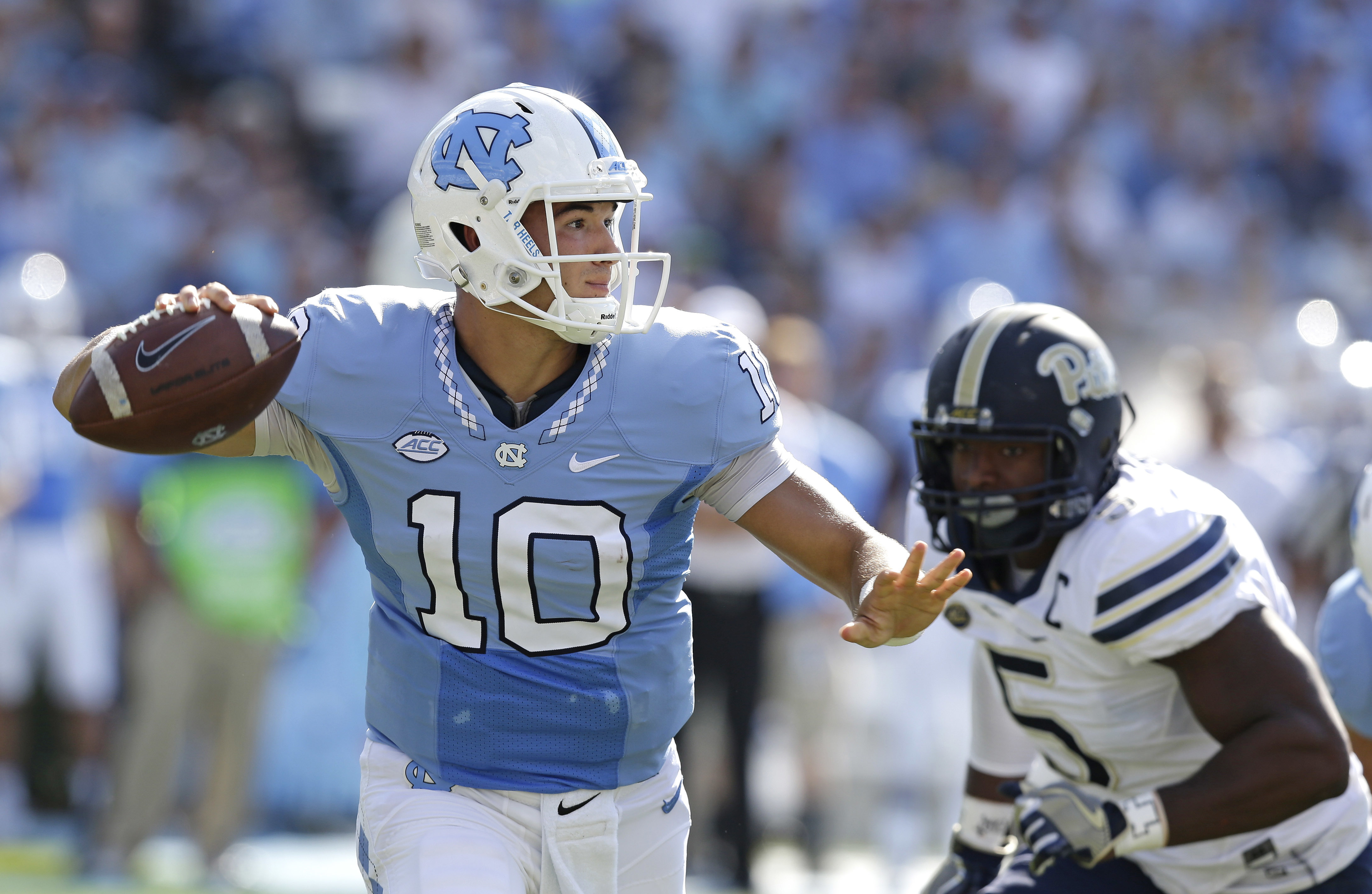 North Carolina quarterback Mitch Trubisky (10) passes as Pittsburgh's Ejuan Price (5) rushes during the first half of an NCAA college football game in Chapel Hill, N.C., Saturday, Sept. 24, 2016. (AP Photo/Gerry Broome)