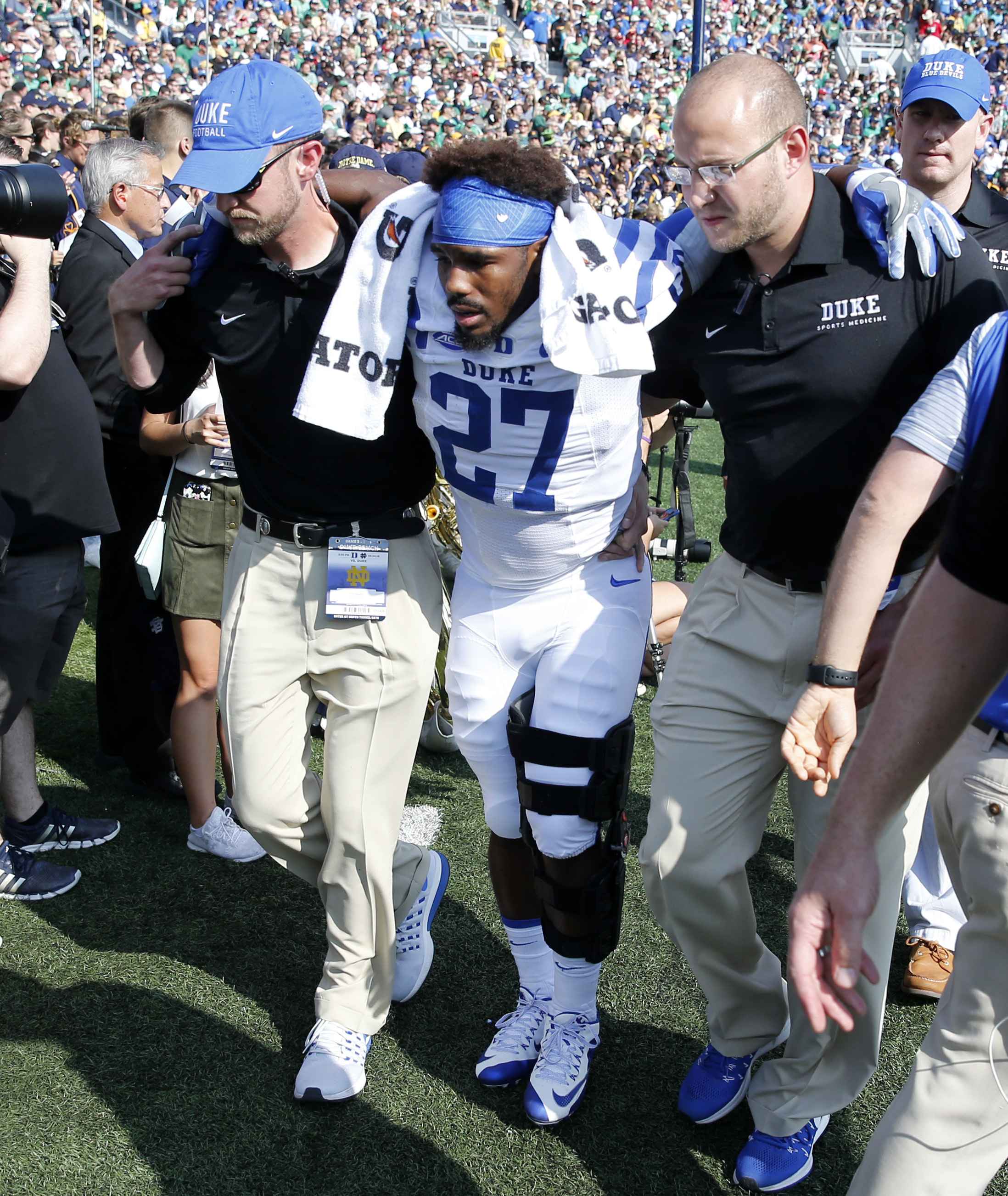 Duke safety DeVon Edwards, center, is taken to the locker room after a left leg injury during the first half of an NCAA college football game against Notre Dame, Saturday, Sept. 24, 2016, in South Bend, Ind. (AP Photo/Charles Rex Arbogast)