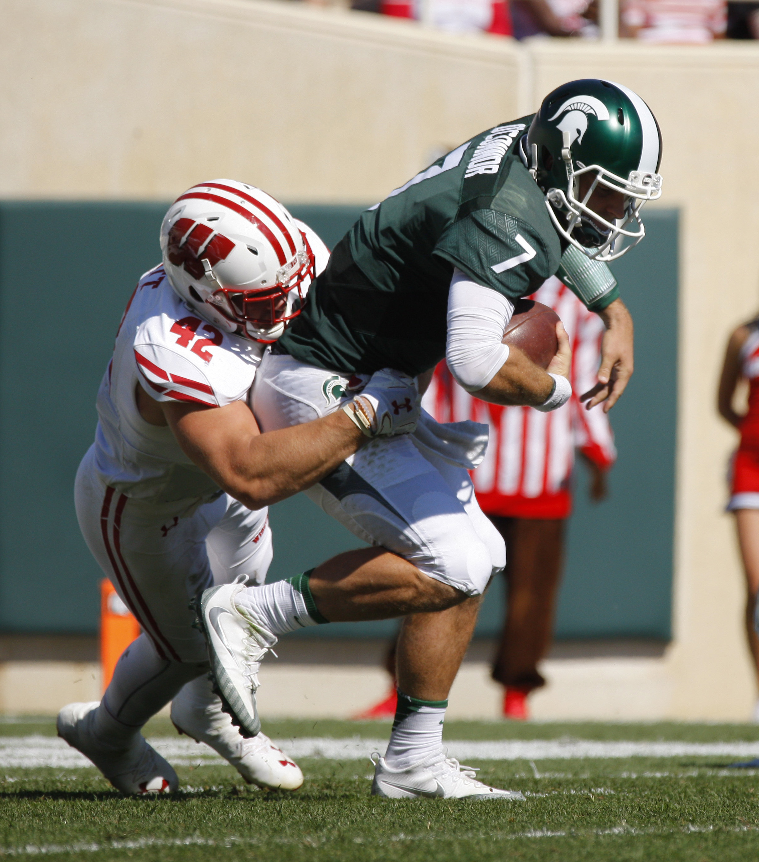 Wisconsin's T.J. Watt, left, sacks Michigan State quarterback Tyler O'Connor (7) during the fourth quarter of an NCAA college football game, Saturday, Sept. 24, 2016, in East Lansing, Mich. Wisconsin won 30-6. (AP Photo/Al Goldis)