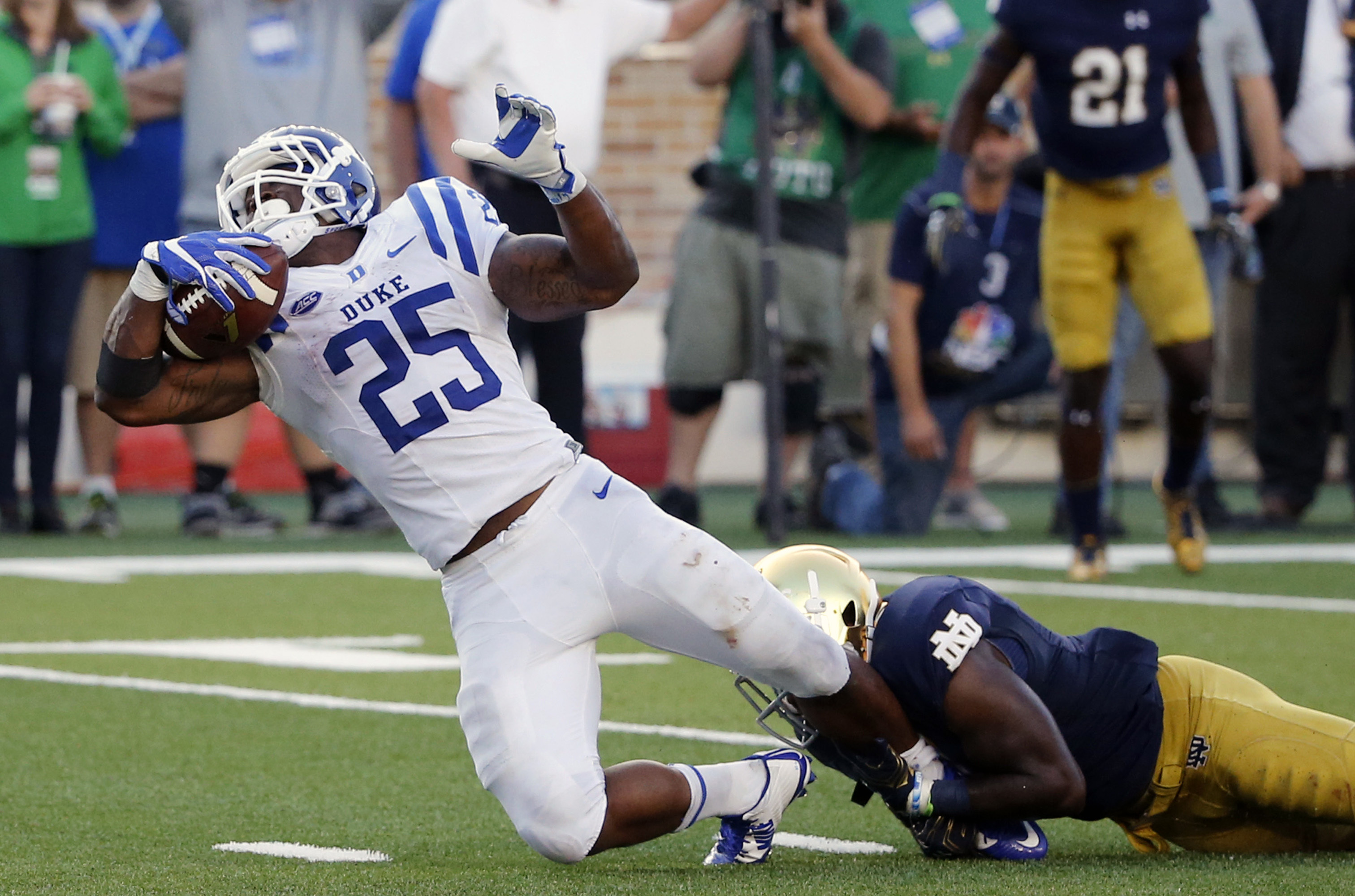 Duke running back Jela Duncan (25) is tackled by Notre Dame safety Avery Sebastian during the second half of an NCAA college football game Saturday, Sept. 24, 2016, in South Bend, Ind. (AP Photo/Charles Rex Arbogast)