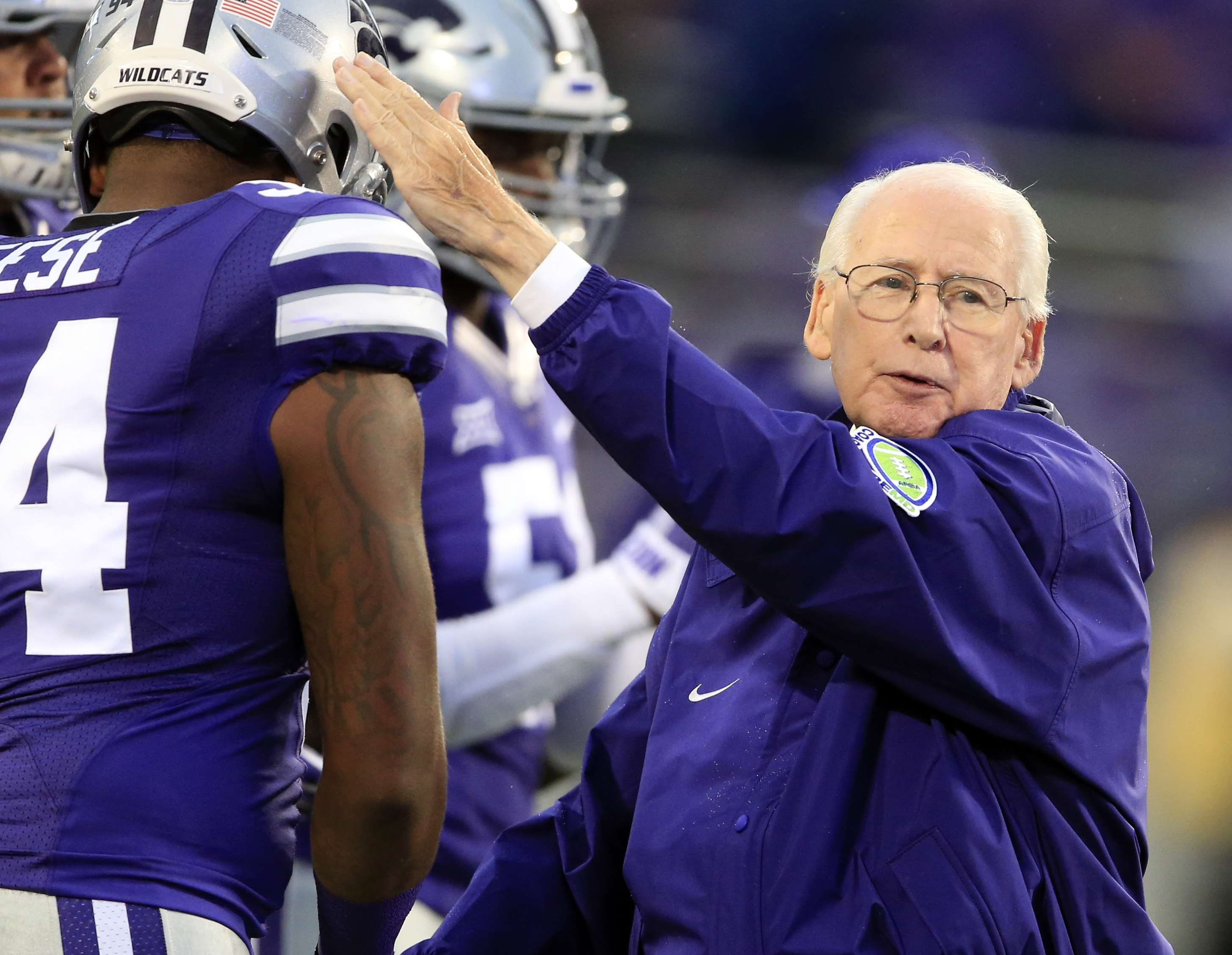 Kansas State coach Bill Snyder pats the shoulder of defensive end C.J. Reese (94) before the team's NCAA college football game against Missouri State in Manhattan, Kan., Saturday, Sept. 24, 2016. (AP Photo/Orlin Wagner)