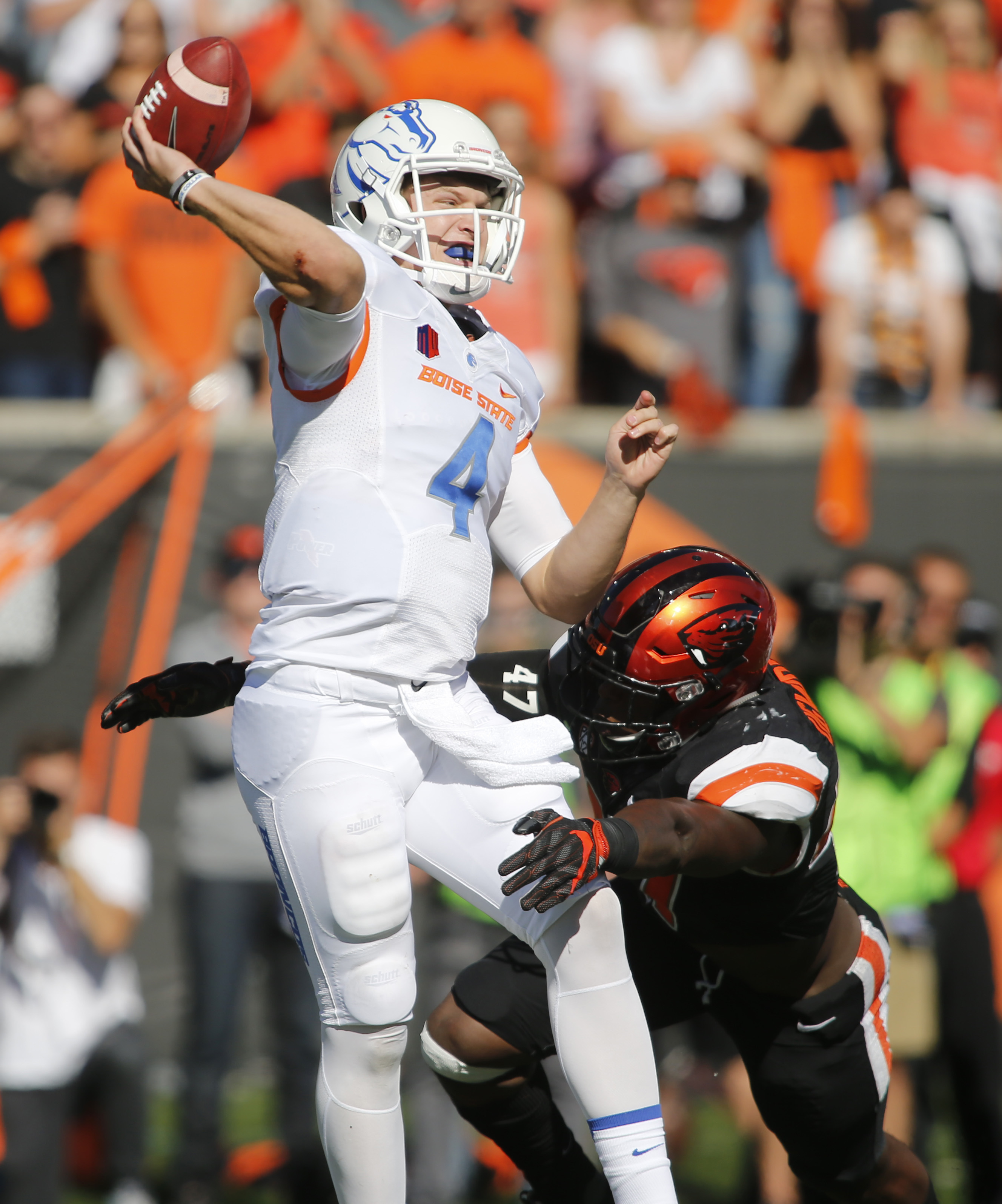 Boise State quarterback Brett Rypien gets a pass off while being pressured by Oregon State's Bright Ugwoegbu in the second half of an NCAA college football game in Corvallis, Ore., on Saturday, Sept. 24, 2016. Boise State won 38-24. (AP Photo/Timothy J. G