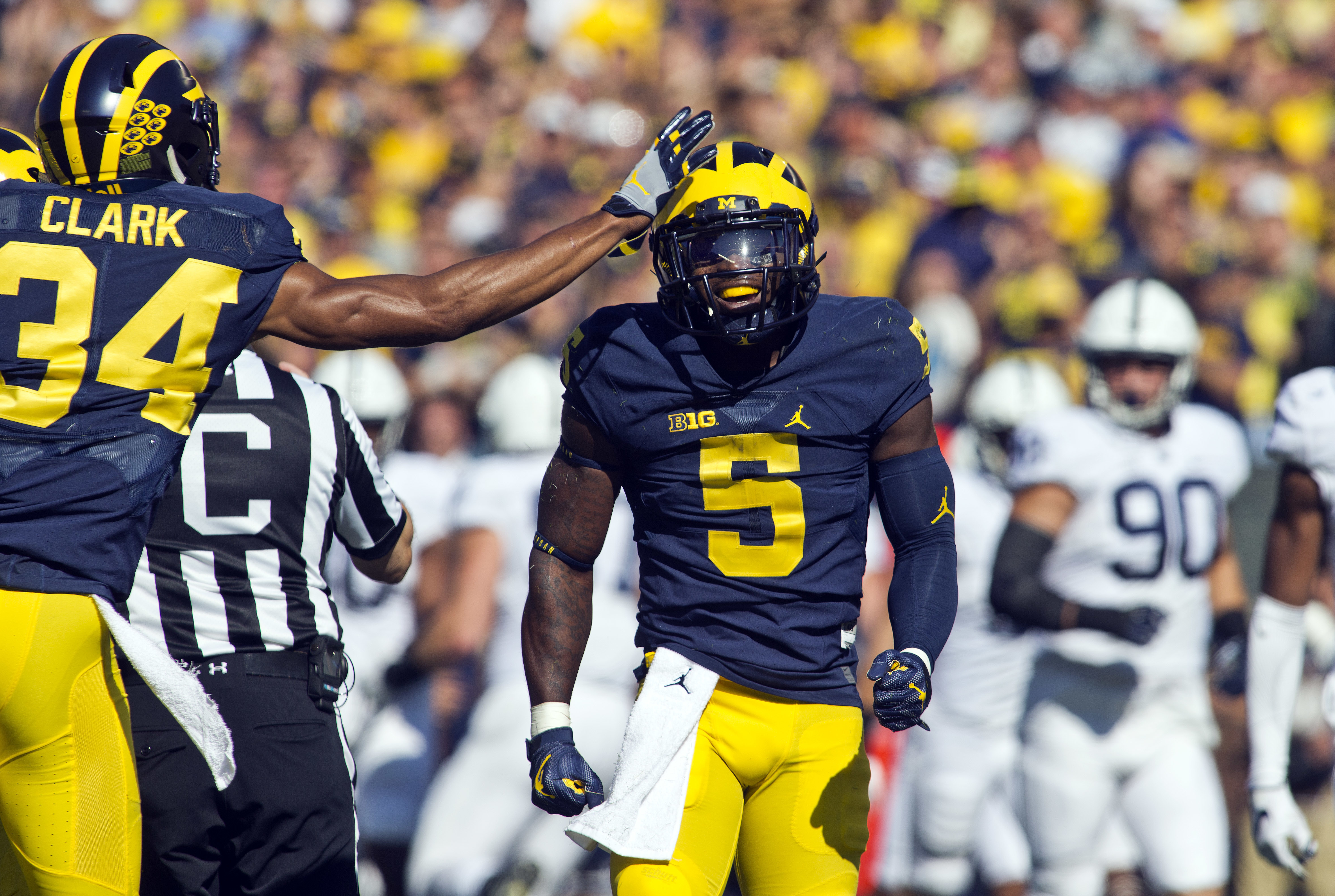 Michigan cornerback Jeremy Clark (34) celebrates a 53-yard punt return by linebacker Jabrill Peppers (5) in the first quarter of an NCAA college football game against Penn State at Michigan Stadium in Ann Arbor, Mich., Saturday, Sept. 24, 2016. Michigan w