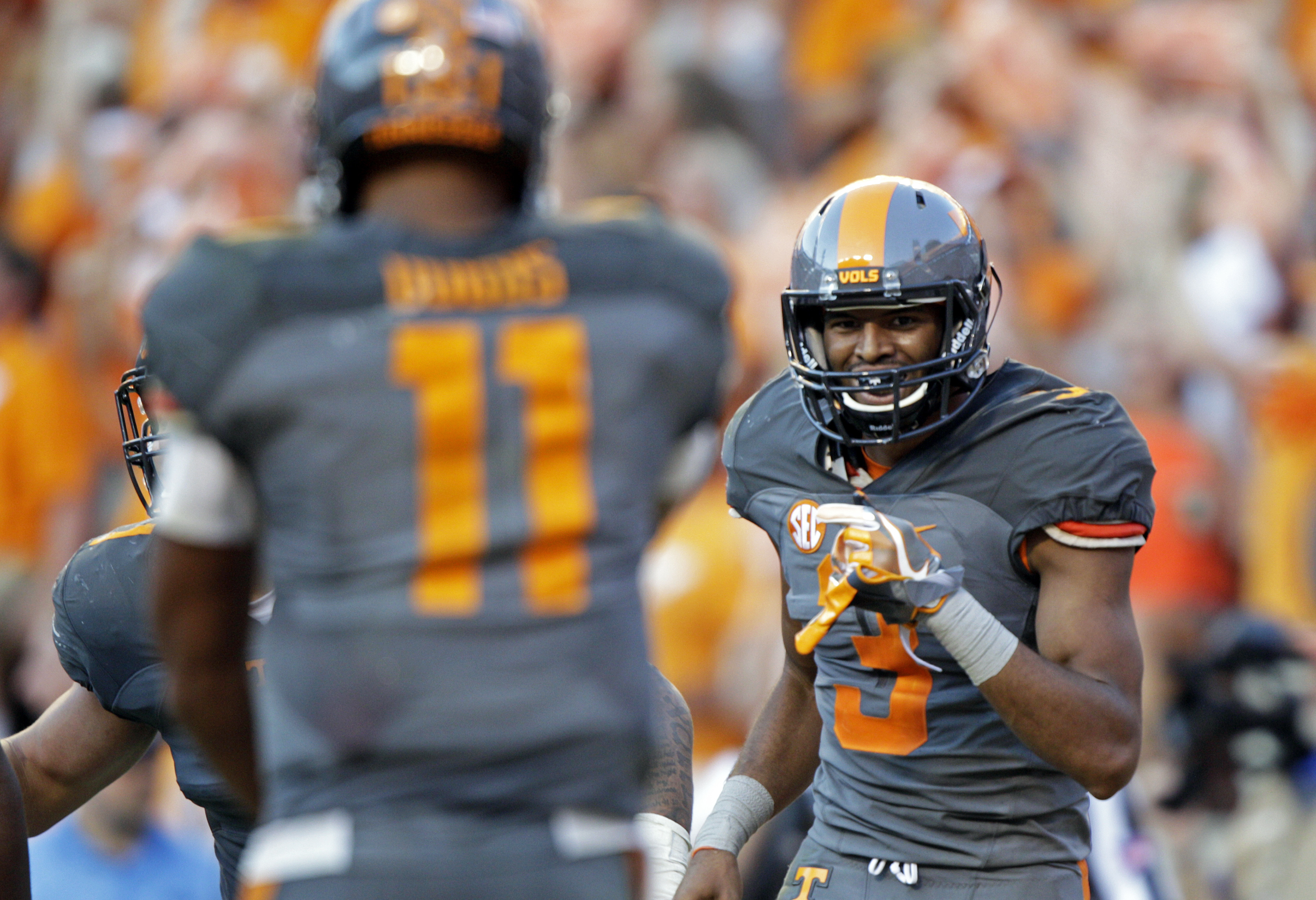 Tennessee wide receiver Josh Malone (3) reacts to a touchdown pass from quarterback Joshua Dobbs (11) during the second half of an NCAA college football game Saturday, Sept. 24, 2016, in Knoxville, Tenn. Tennessee won 38-28. (AP Photo/Wade Payne)