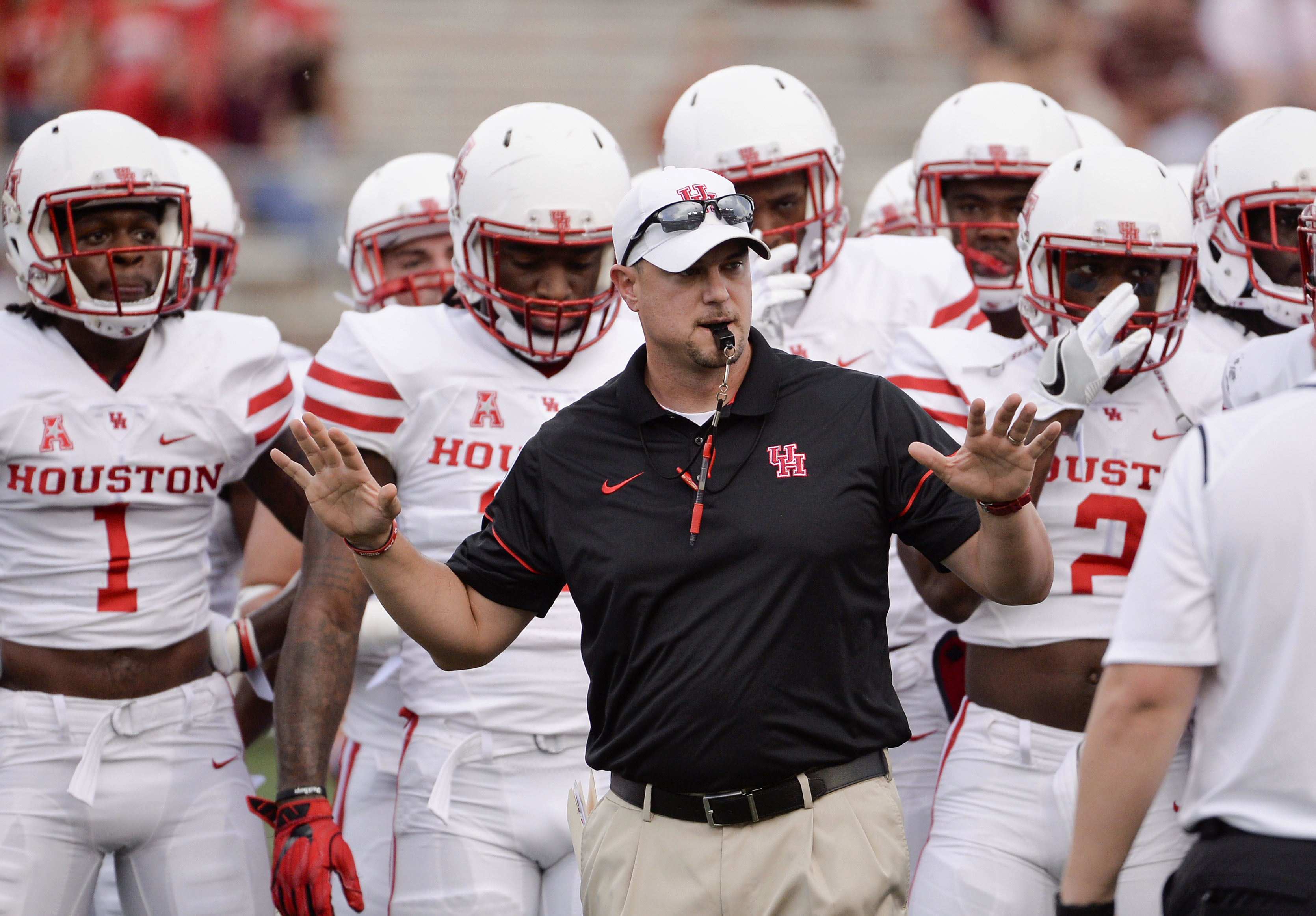 Houston head coach Tom Herman runs drills with his team before an NCAA college football game against Texas State, Saturday, Sept. 24, 2016, in San Marcos, Texas. (AP Photo/Darren Abate)