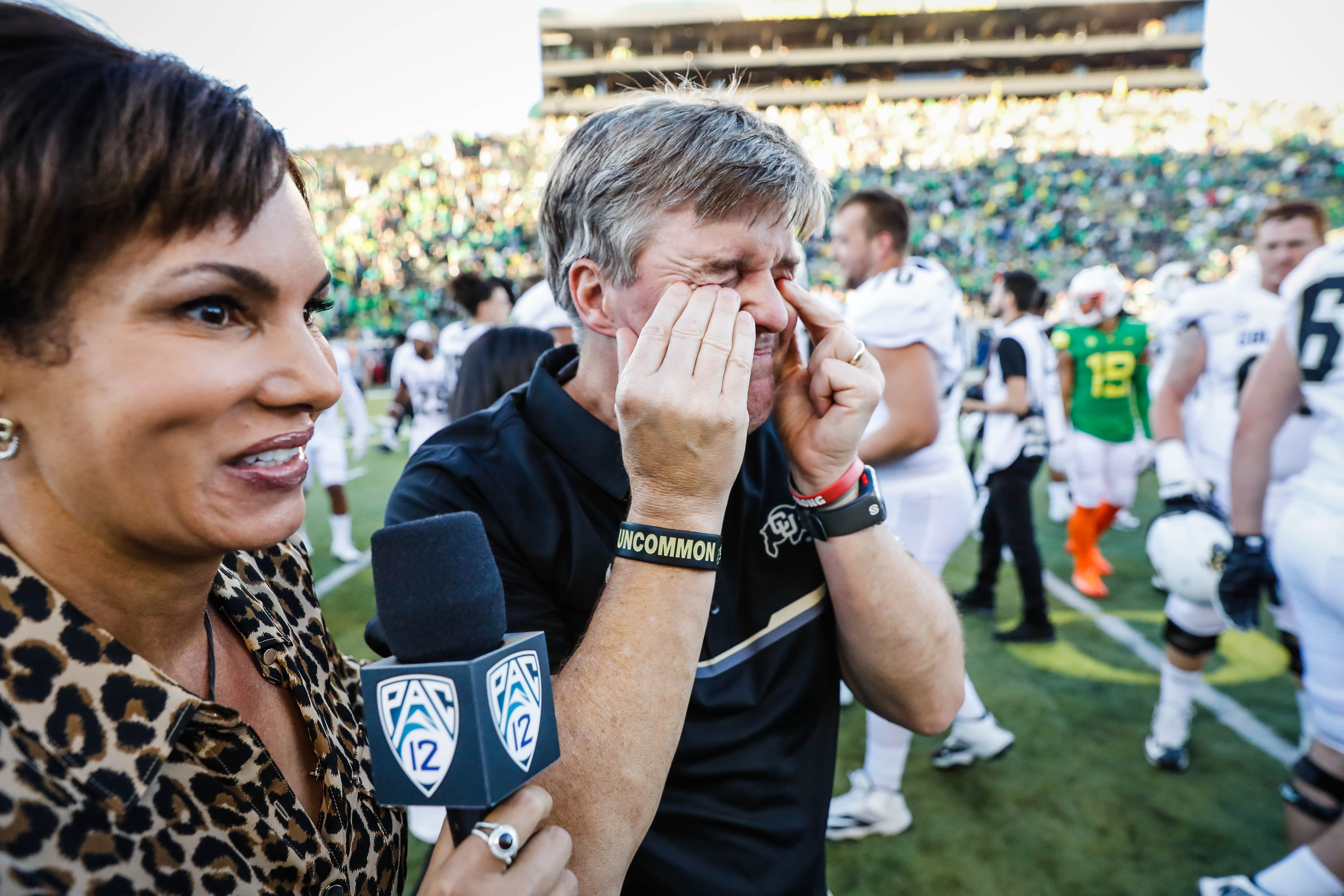 Colorado head coach Mike MacIntyre wipes tears from his eyes before his television interview after their win over Oregon in an NCAA college football game Saturday, Sept. 24, 2016 in Eugene, Ore. (AP Photo/Thomas Boyd)