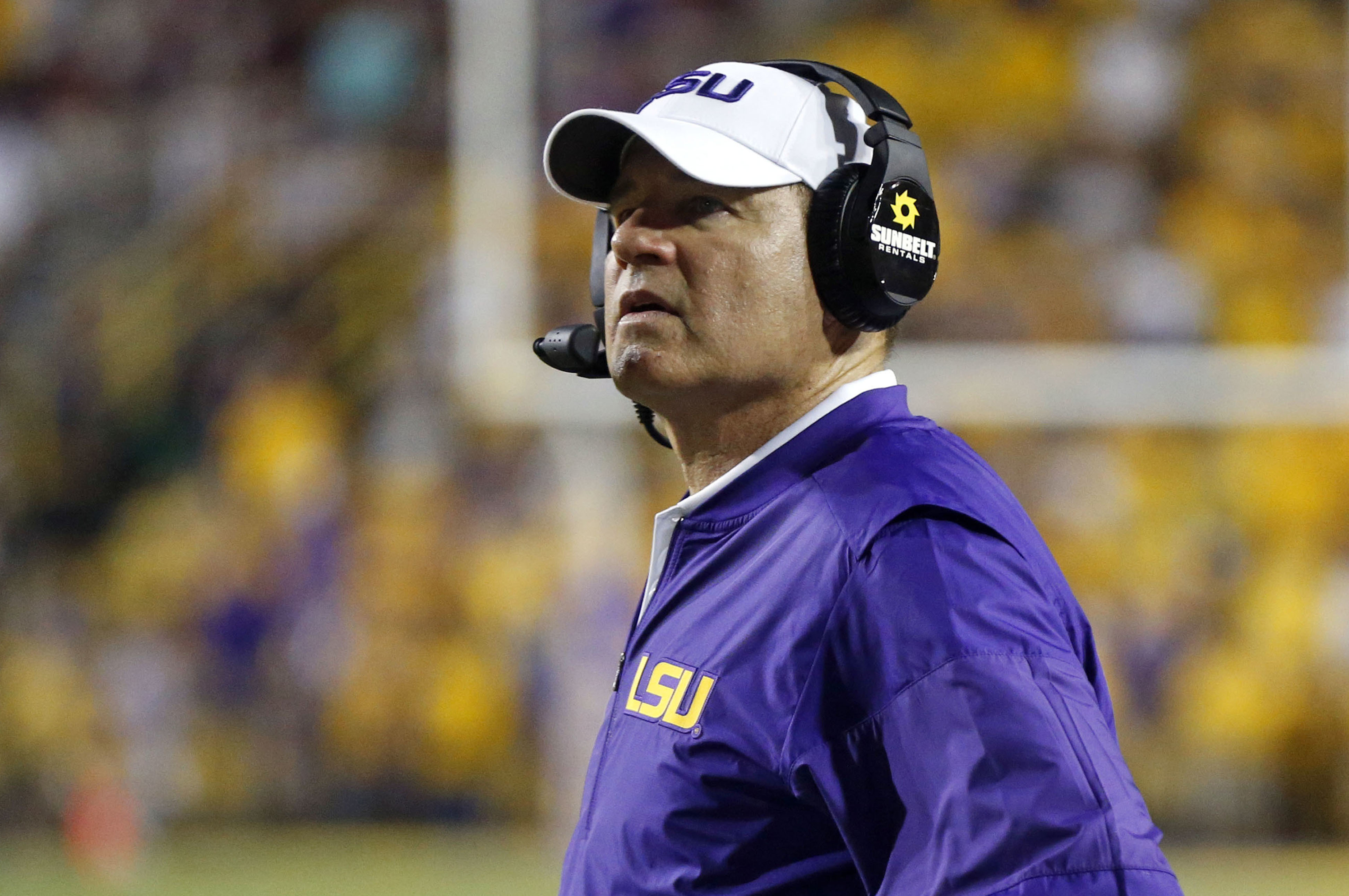 FILE - This Sept. 17, 2016 file photo shows LSU head coach Les Miles watching from the sideline in the second half of an NCAA college football game against Mississippi State in Baton Rouge, La. Two people familiar with the decision say LSU has fired Miles