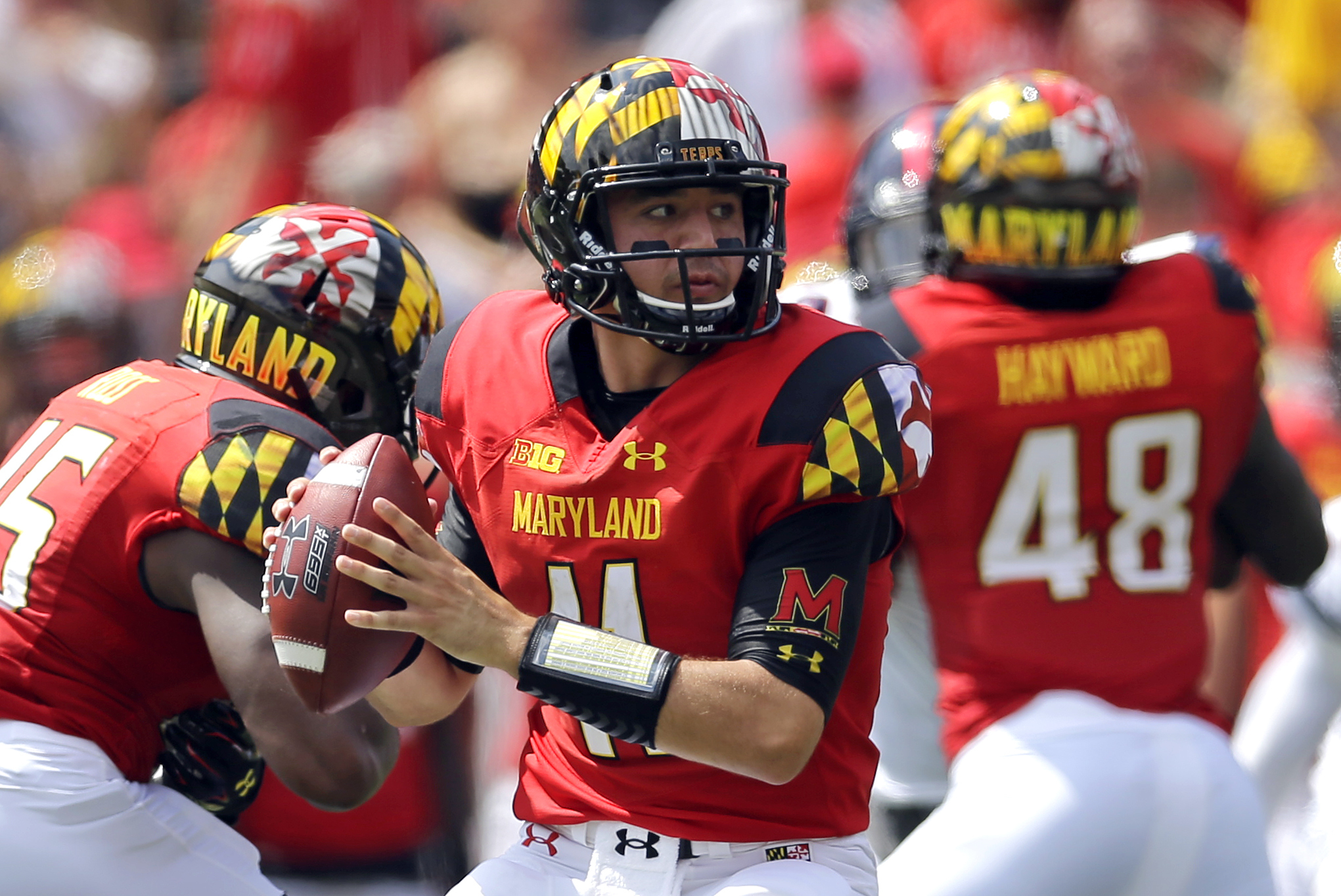 FILE - In this Sept. 5, 2015, file photo, Maryland quarterback Perry Hills looks for a receiver in the first half of an NCAA college football game against Richmond,in College Park, Md. Though first-year coach DJ Durkin is known for his defensive prowess,