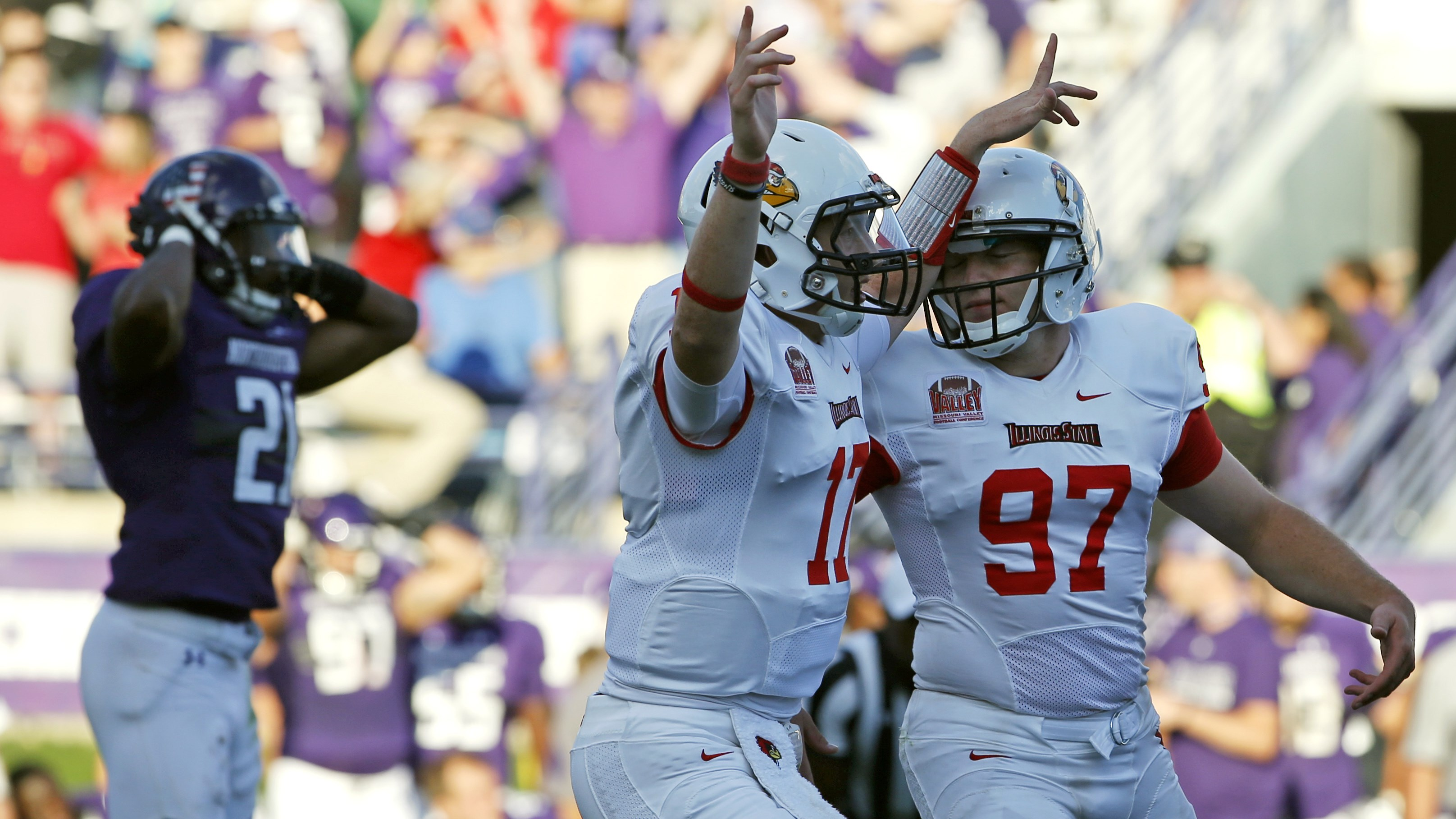 Illinois State kicker Sean Slattery (97) celebrates with quarterback Koty Thelen (17) after scoring the game-winning field goal as Northwestern running back Justin Jackson, left, reacts during the second half of an NCAA college football game in Evanston,