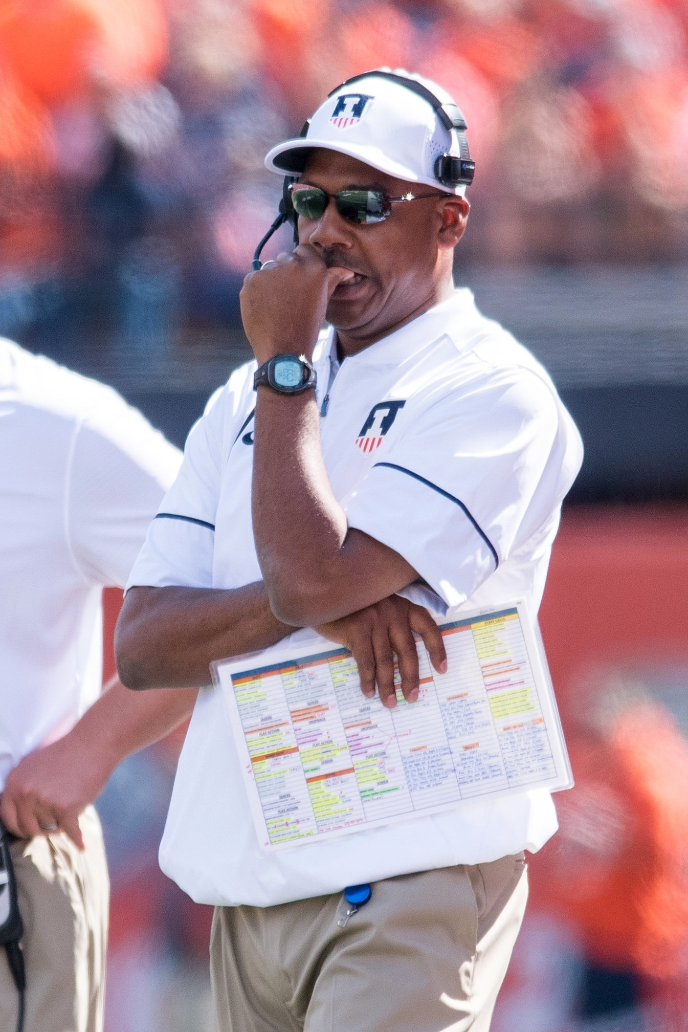FILE - In this Sept. 3, 2016 file photo, Illinois offensive coordinator Garrick McGee stands on the sideline of an NCAA college football game against Murray State, in Champaign, Ill. The Illini take on No. 15 Nebraska on Saturday in Lincoln, Neb.(AP Photo