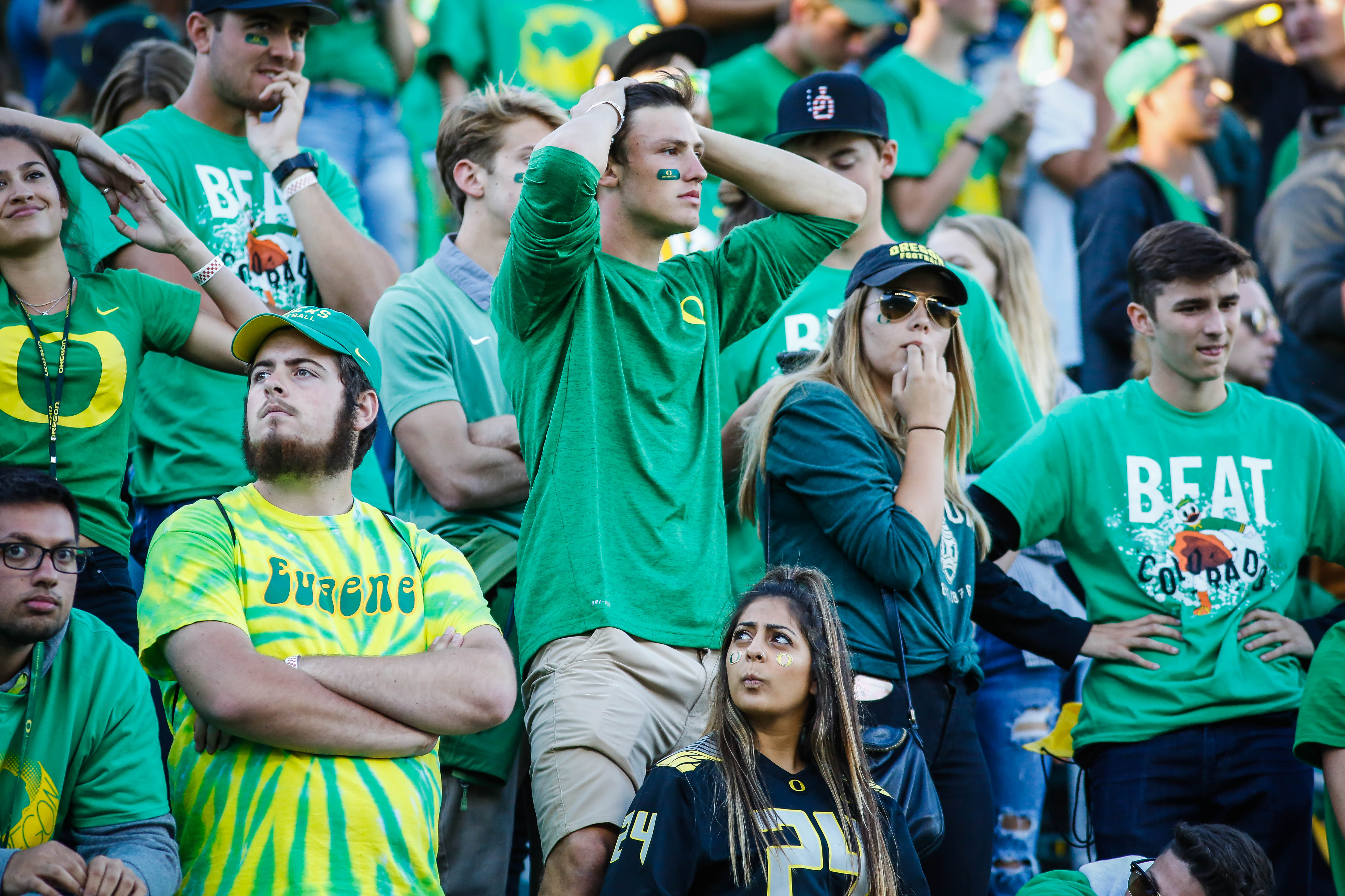 FILE - In this Sept. 24, 2016 file photo, Oregon fans react to the last second interception that sealed their loss against Colorado in an NCAA college football game in Eugene, Ore.  Veteran Oregon players addressed their teammates on a practice field on M