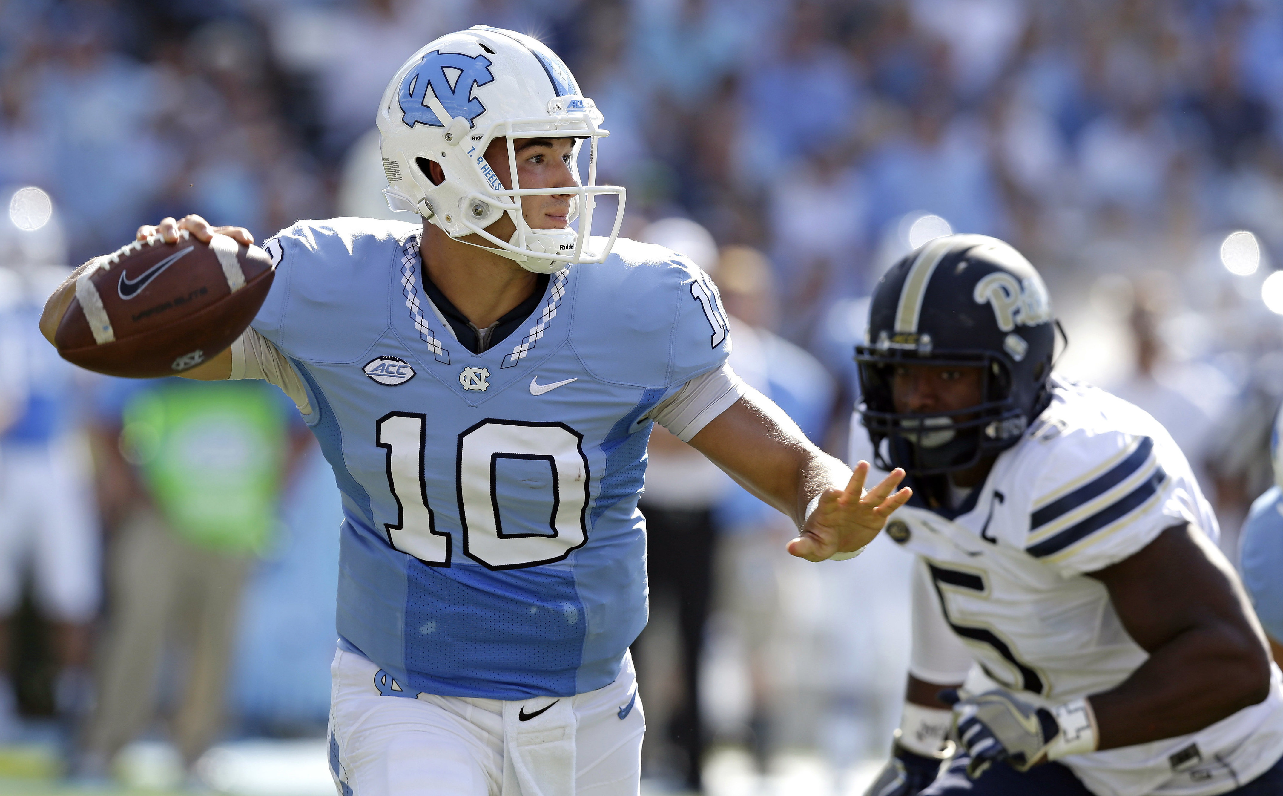 FILE - In this Sept. 24, 2016, file photo, North Carolina quarterback Mitch Trubisky (10) throws a pass as Pittsburgh's Ejuan Price (5) rushes during the first half of an NCAA college football game in Chapel Hill, N.C. UNC's takes on Florida State in an A