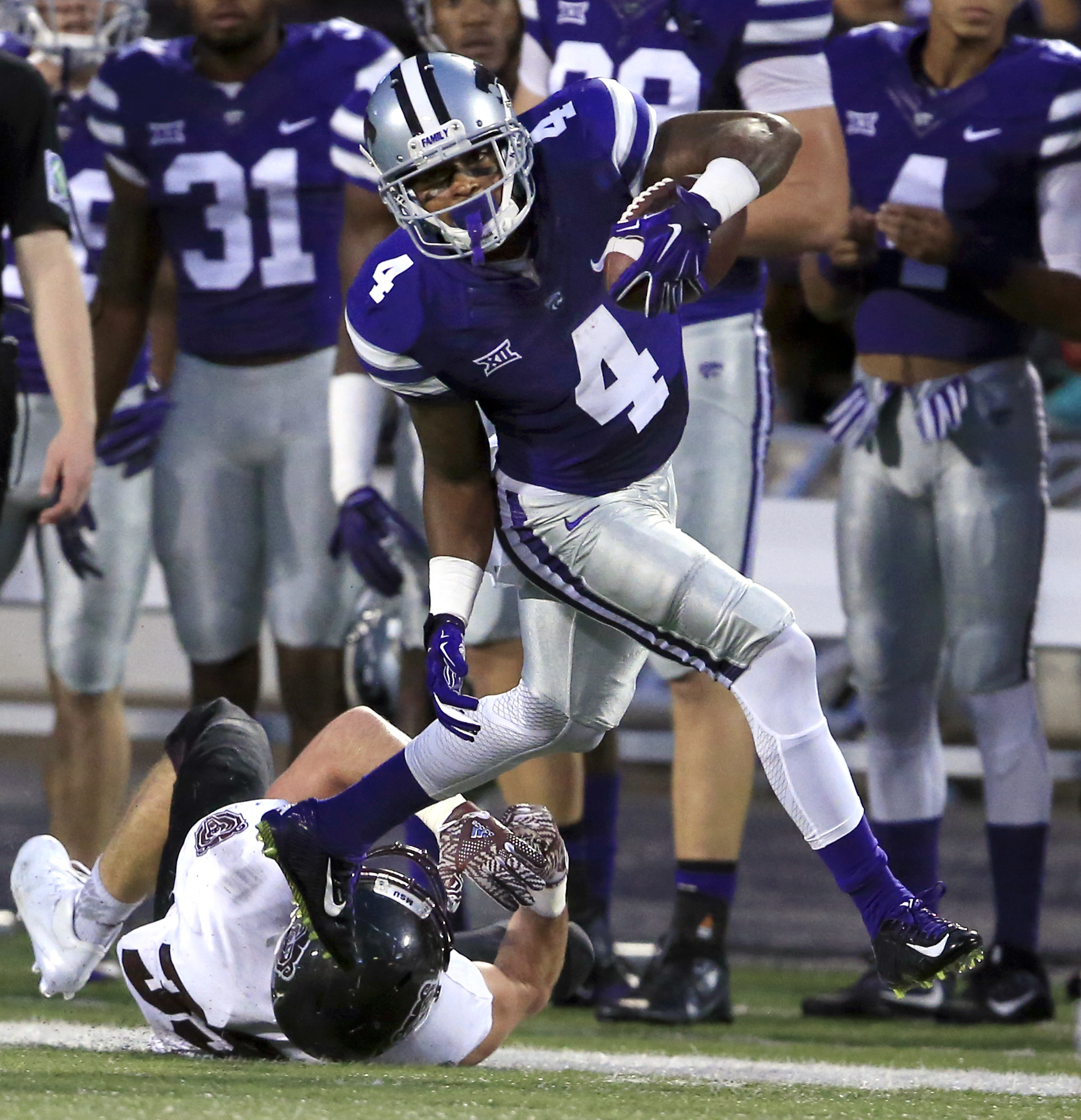 FILE - In this Saturday, Sept. 24, 2016 file photo, Kansas State kick returner Dominique Heath (4) runs over Missouri State's Nick Masoner (39) during the first half of an NCAA college football game in Manhattan, Kan. West Virginia has been burned by Kans
