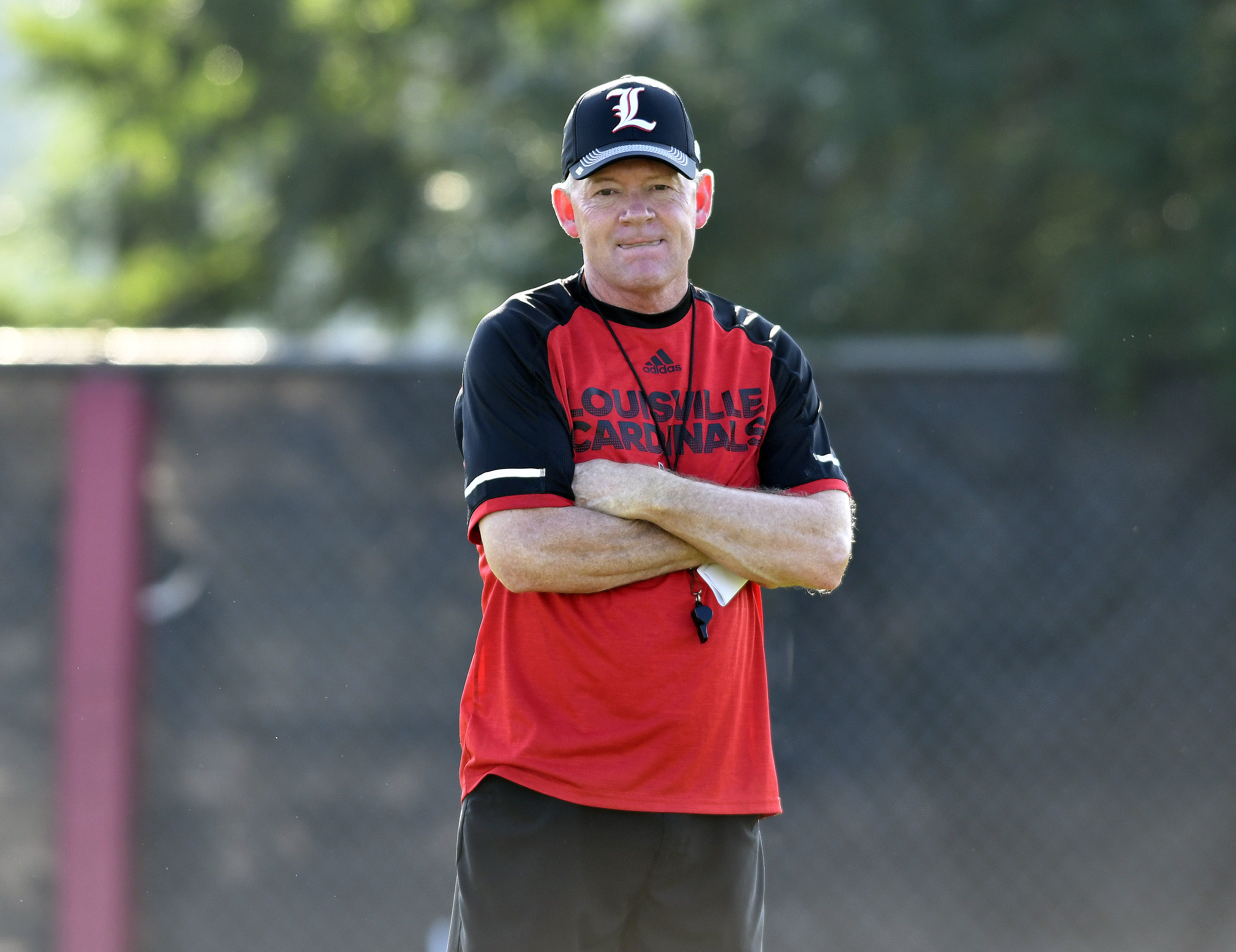 FILE - In this Aug. 5, 2016, file photo, Louisville coach Bobby Petrino looks on as his team goes through workouts during NCAA college football practice in Louisville Ky. Four and a half years after being fired by Long at Arkansas as a pariah, Petrino is