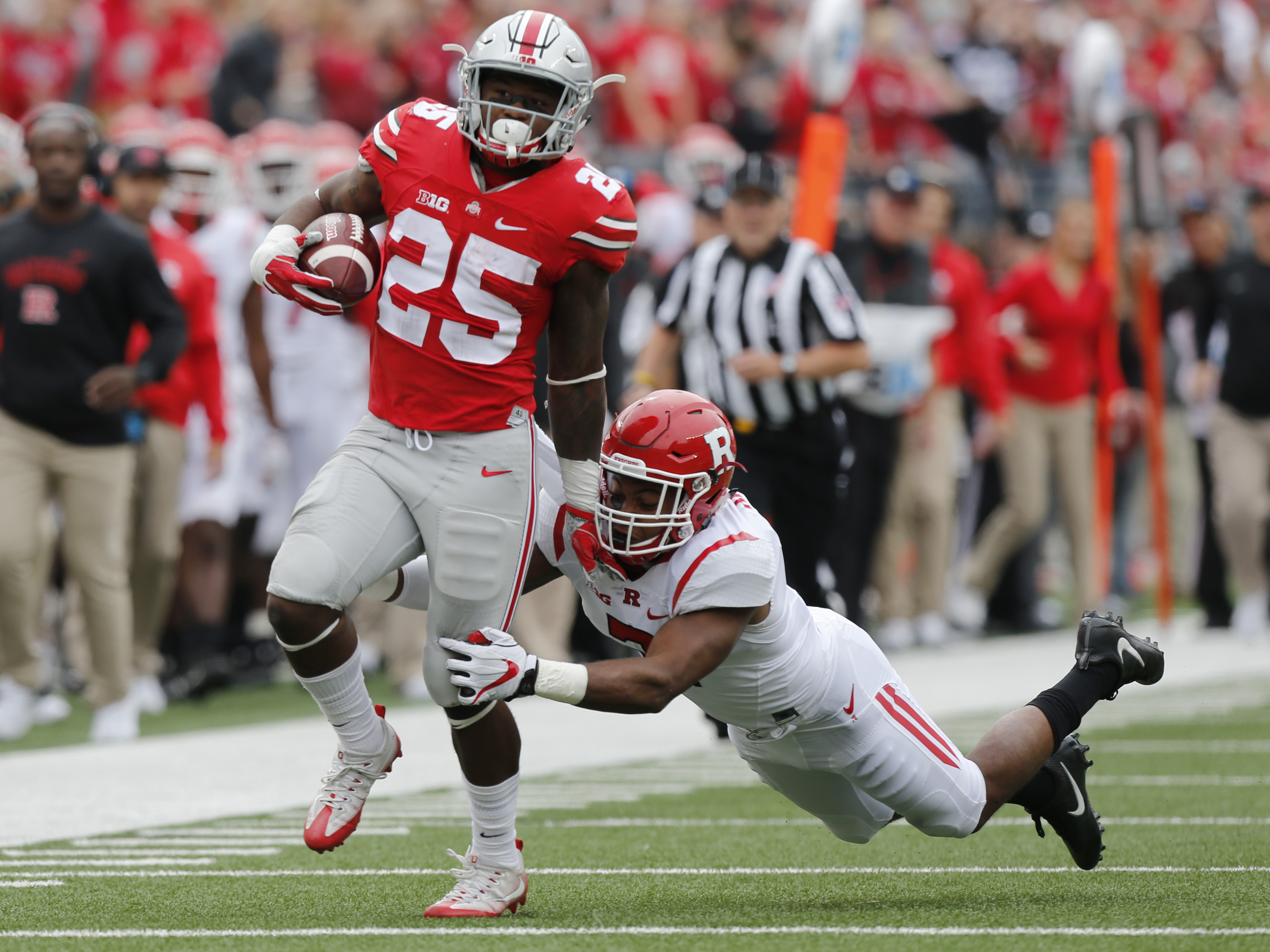 Ohio State running back Mike Weber, left, is forced out-of-bounds by Rutgers defensive back Kiy Hester during the first half of an NCAA college football game Saturday, Oct. 1, 2016, in Columbus, Ohio. (AP Photo/Jay LaPrete)