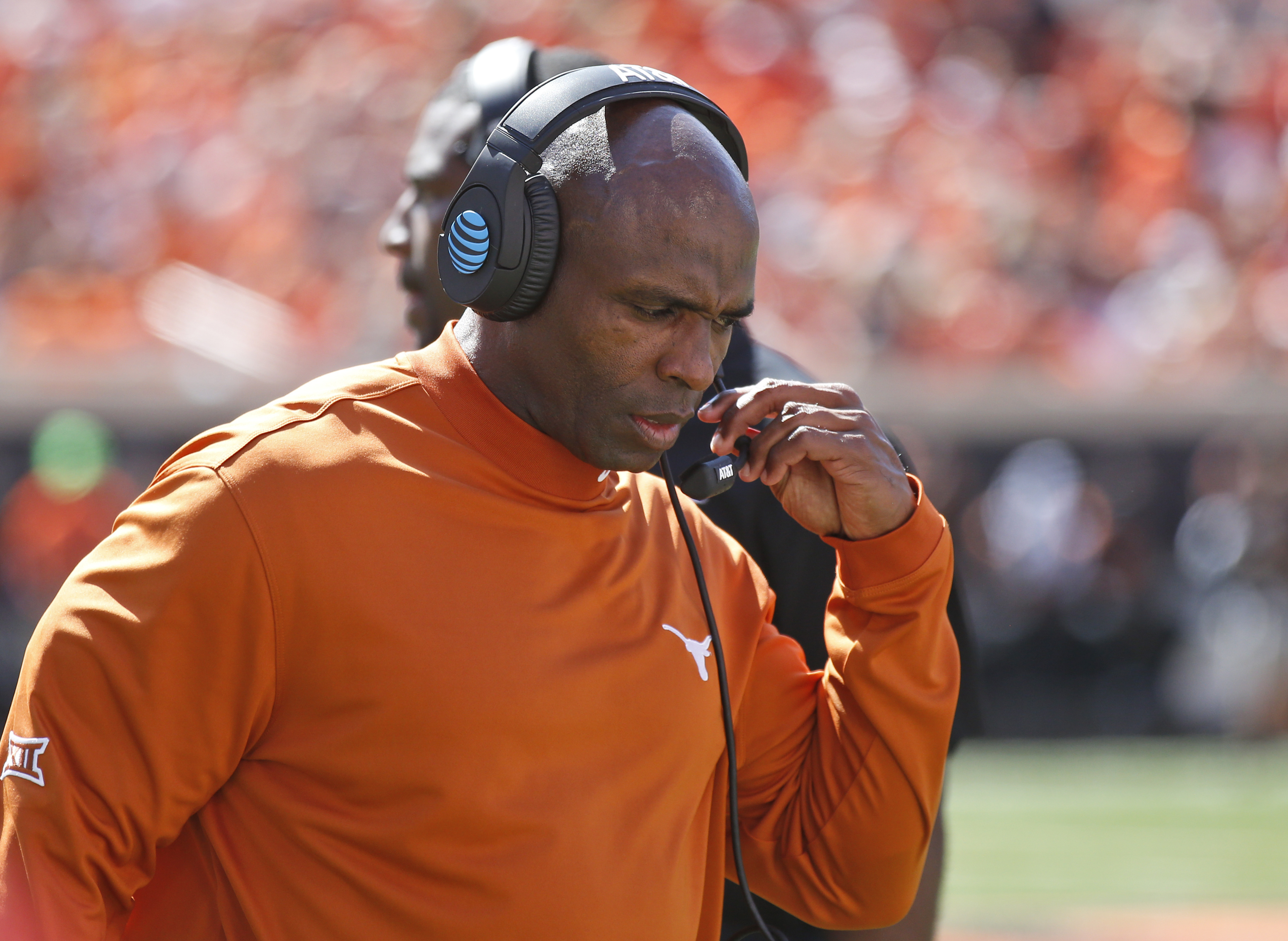 Texas head coach Charlie Strong walks along the sideline during an NCAA college football game against Oklahoma State in Stillwater, Okla., Saturday, Oct. 1, 2016. Oklahoma State won 49-31. (AP Photo/Sue Ogrocki)