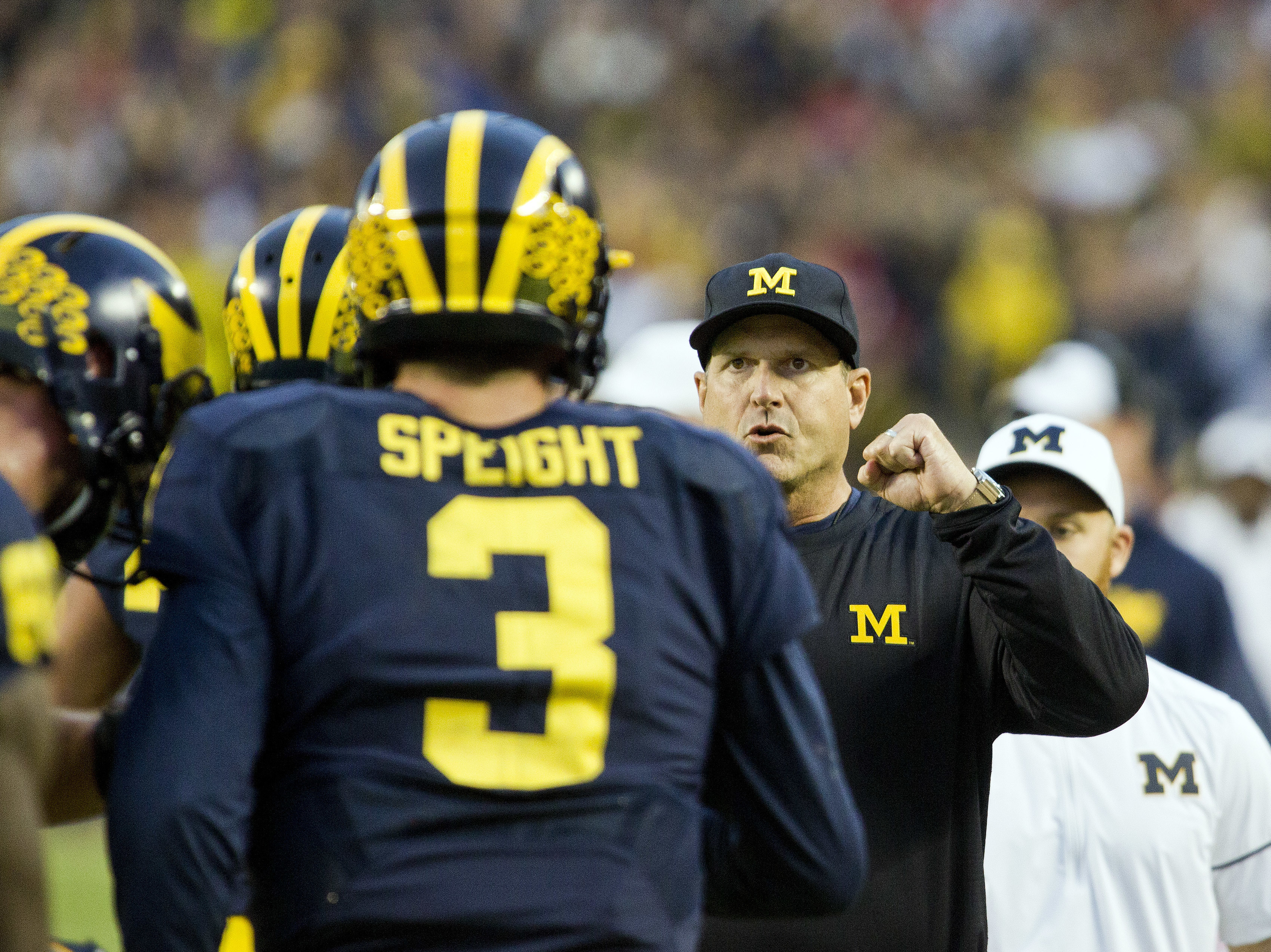 Michigan quarterback Wilton Speight (3) celebrates with head coach Jim Harbaugh, center, after a Michigan touchdown in the fourth quarter of an NCAA college football game against Wisconsin at Michigan Stadium in Ann Arbor, Mich., Saturday, Oct. 1, 2016. M