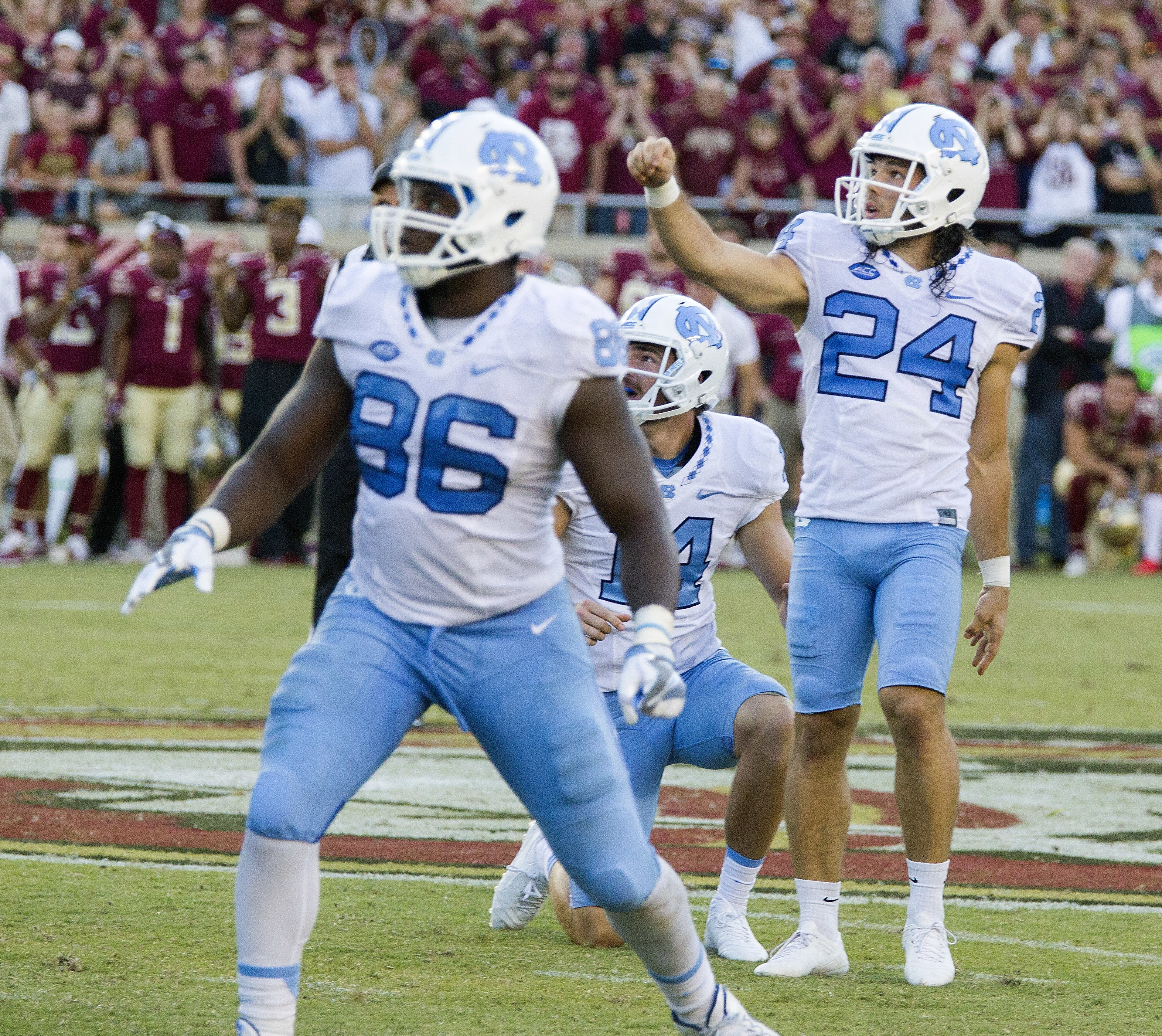 North Carolina kicker Nick Weiler (24) and teammates Carl Tucker (86) and holder Logan Byrd (14) watch Weiler's 54-yard game winning field goal as time expired against Florida State in an NCAA college football game in Tallahassee, Fla., Saturday, Oct. 1,