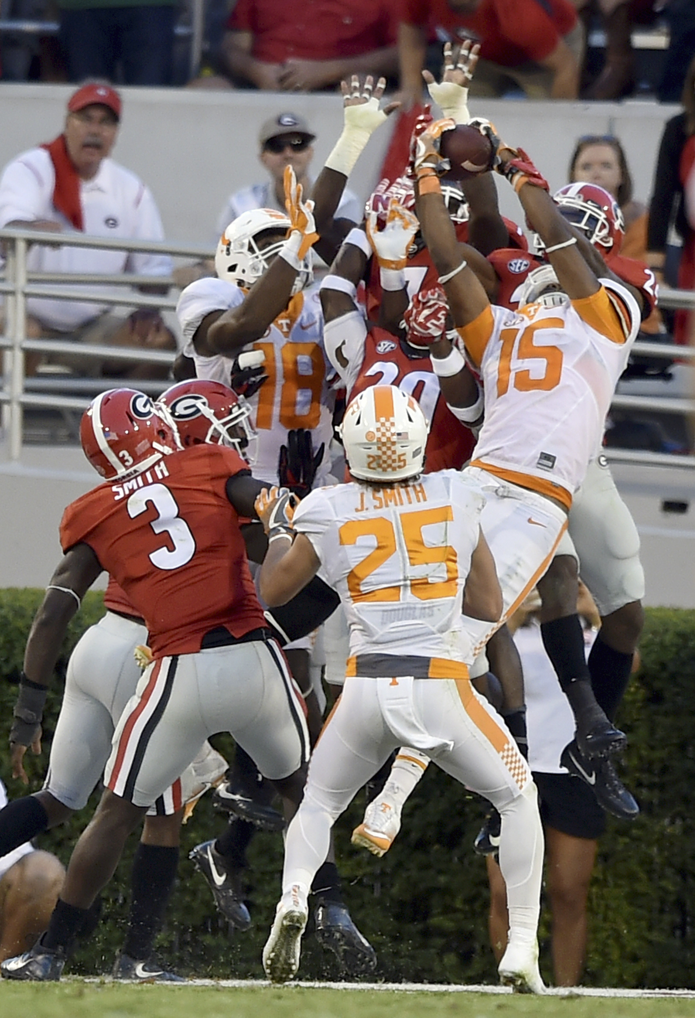 Tennessee wide receiver Jauan Jennings (15) leaps in front of Georgia safety Dominick Sanders for the game winning touchdown as time expires during an NCAA college football game, Saturday, Oct. 1, 2016 in Athens, Ga. (Brant Sanderlin/Atlanta Journal-Const