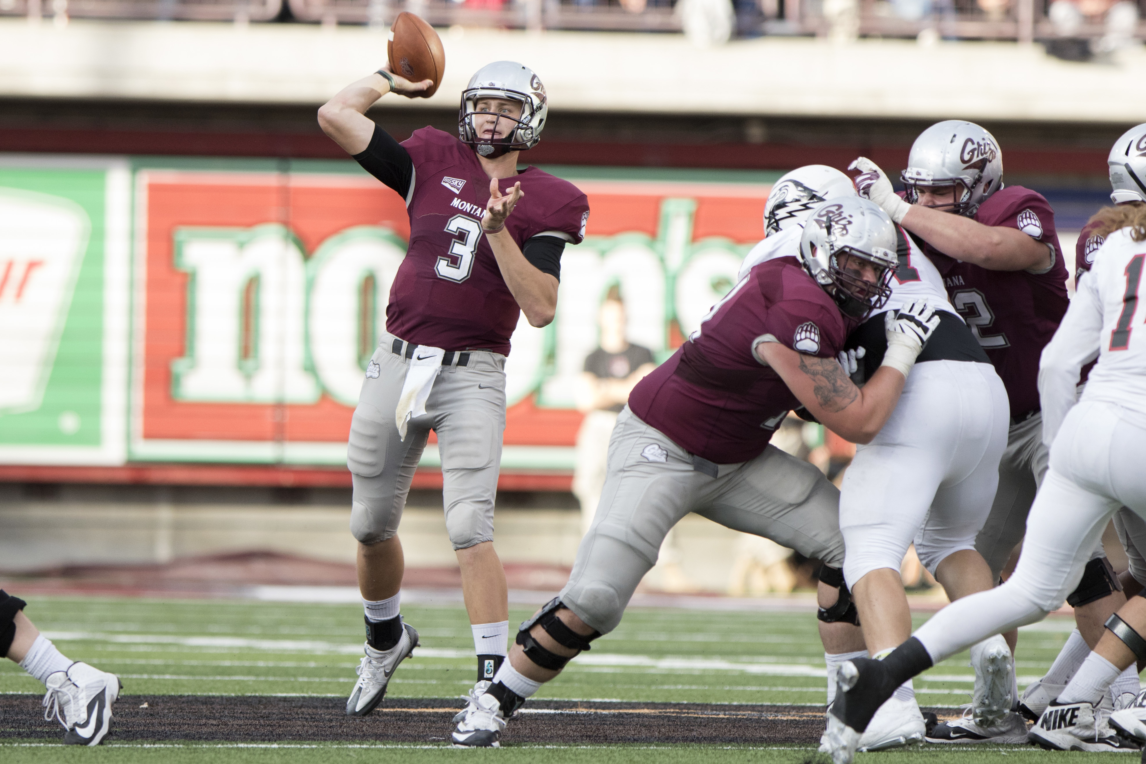 Montana quarterback Brady Gustafson (3) throws a pass against Southern Utah in an NCAA college football game Saturday, Oct. 1, 2016, in Missoula, Mont. Montana defeated Southern Utah, 43-20. (AP Photo/Patrick Record)