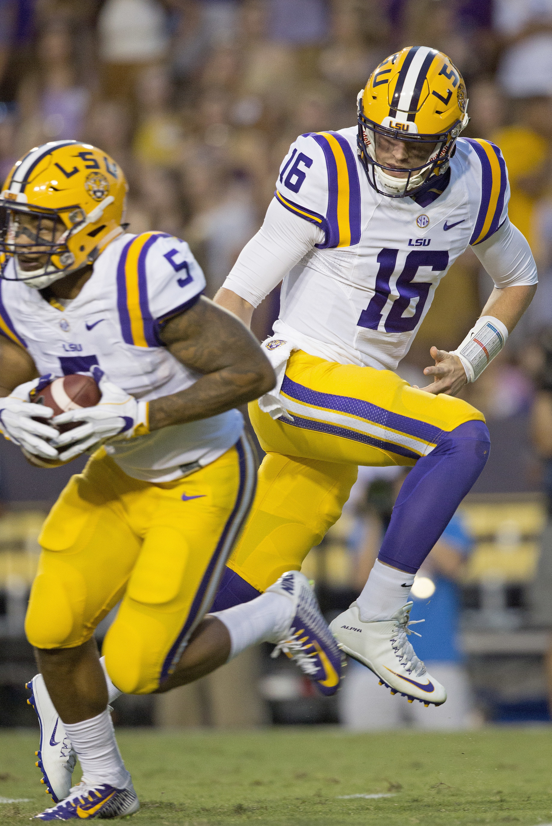 LSU quarterback Danny Etling (16) handoffs to LSU running back Derrius Guice (5) during the first half of an NCAA college football game against Missouri in Baton Rouge, La., Saturday, Oct. 1, 2016. (AP Photo/Max Becherer)