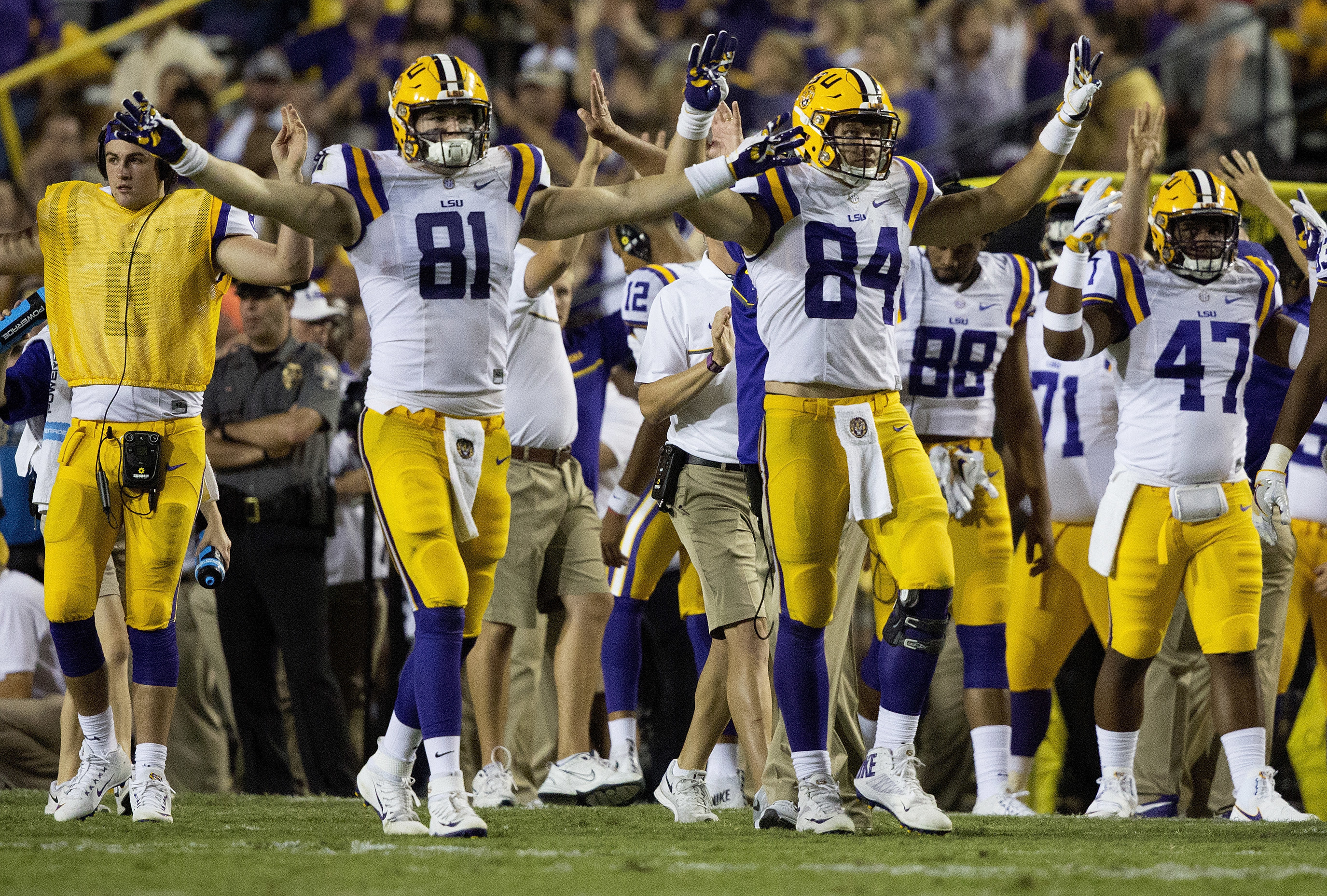 LSU tight ends Colin Jeter (81) and Foster Moreau (84) celebrate as the time winds down during the second half of an NCAA college football game against Missouri in Baton Rouge, La., Saturday, Oct. 1, 2016. LSU won 42-7. (AP Photo/Max Becherer)