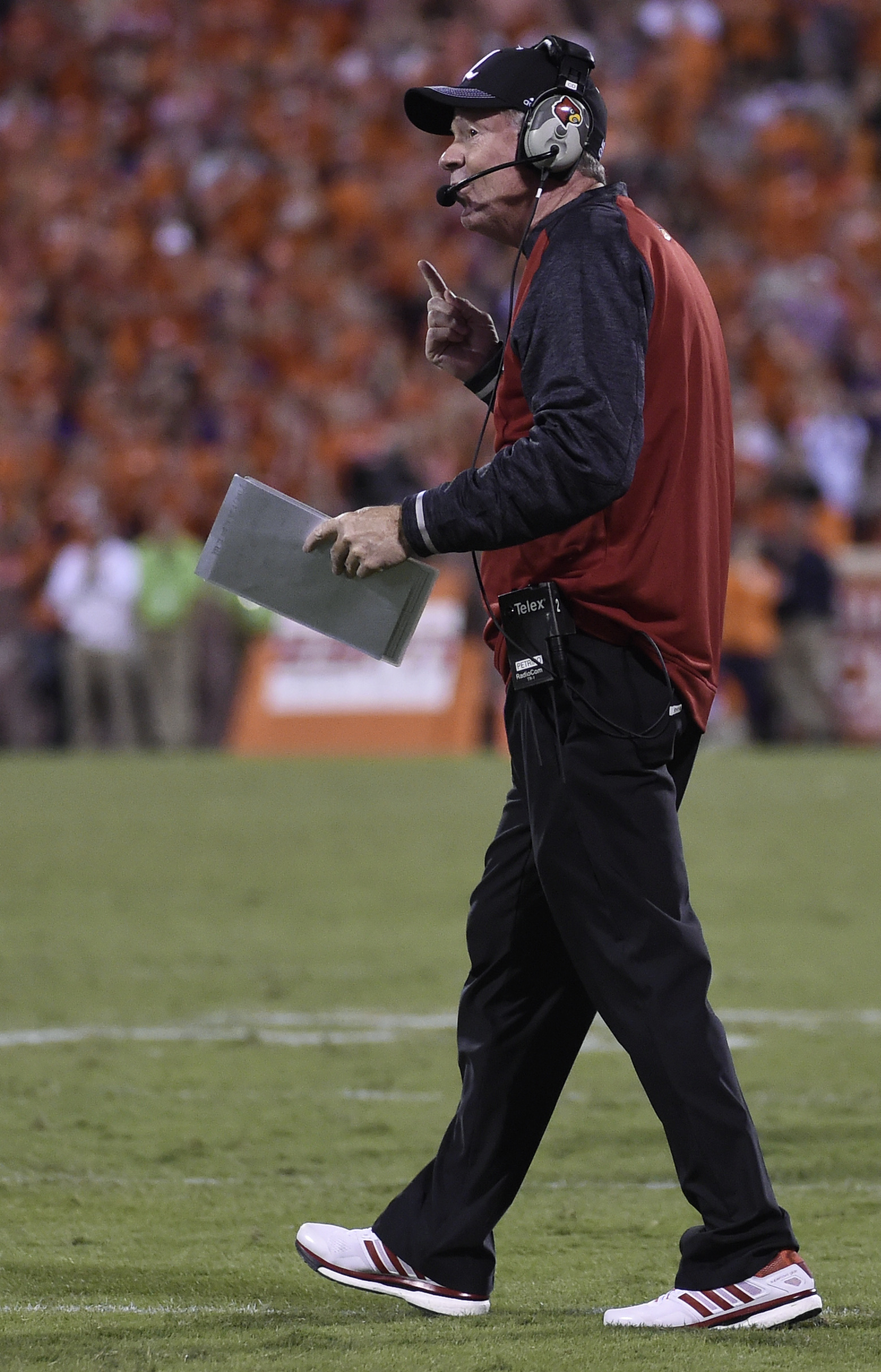 Louisville coach Bobby Petrino gestures from the sideline during the second half of his team's NCAA college football game against Clemson on Saturday, Oct. 1, 2016, in Clemson, S.C. (AP Photo/Rainier Ehrhardt)
