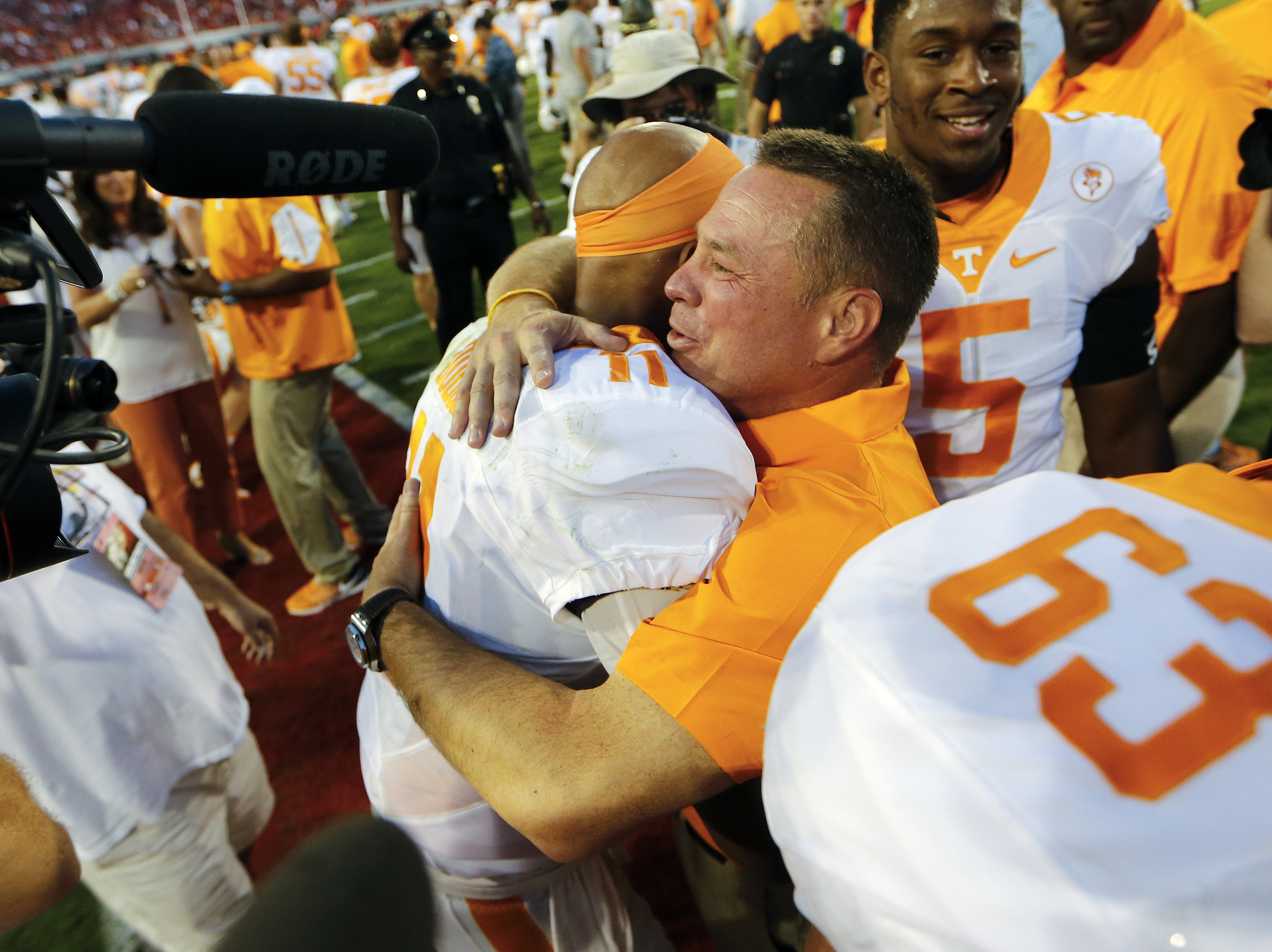 FILE - In this Oct. 1, 2016, file photo, Tennessee head coach  Butch Jones hugs quarterback Joshua Dobbs (11) after defeating Georgia 34-31 in an NCAA college football game, in Athens, Ga. Dobbs completed a last-second pass to wide receiver Jauan Jennings
