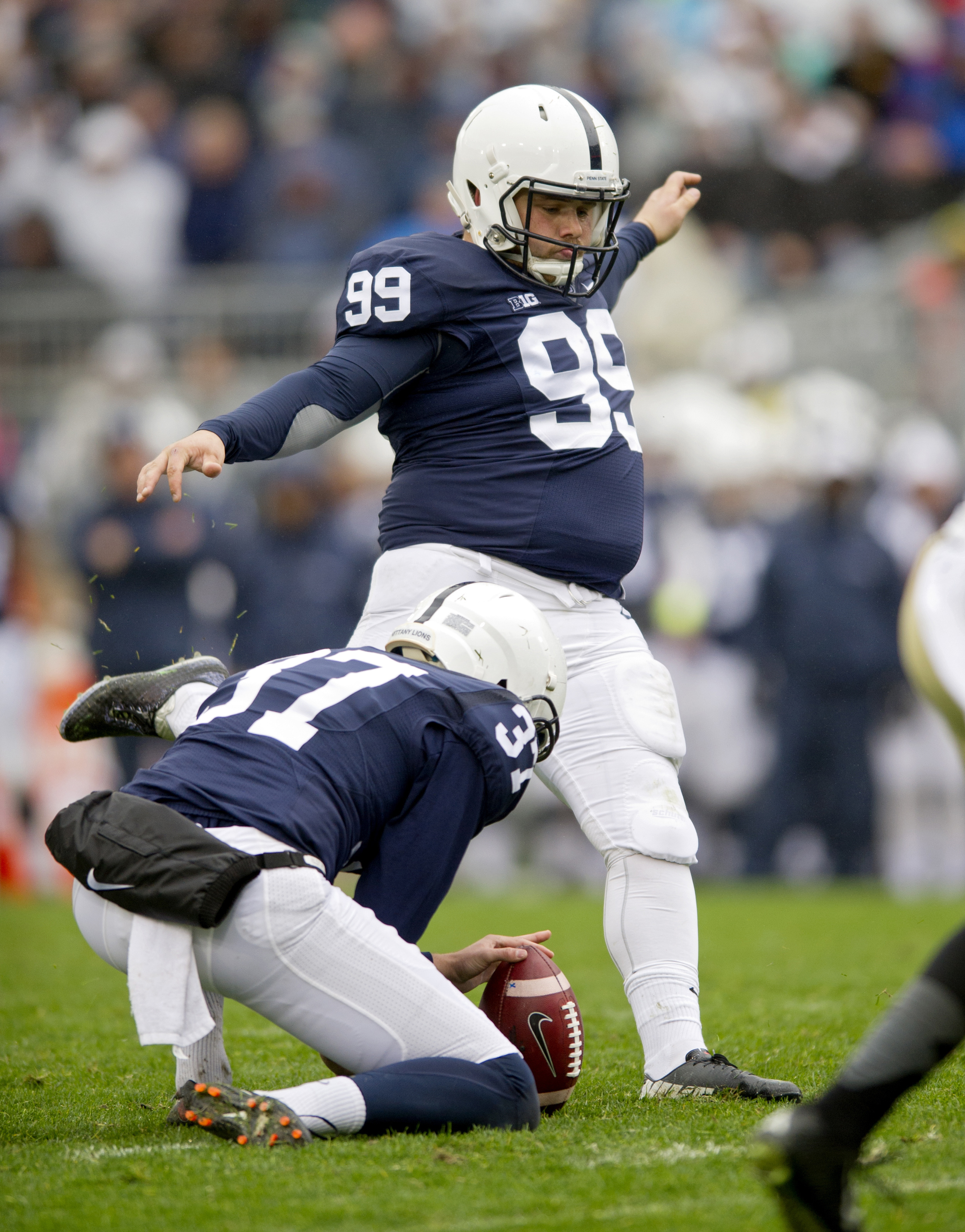 FILE - In this Oct. 3, 2015, file photo, Penn State's Joey Julius kicks a field goal during an NCAA college football game against Army in State College, Pa. Joey Julius, the 258-pound redshirt sophomore,  disclosed in a Facebook post on Sunday, Oct. 2, 20