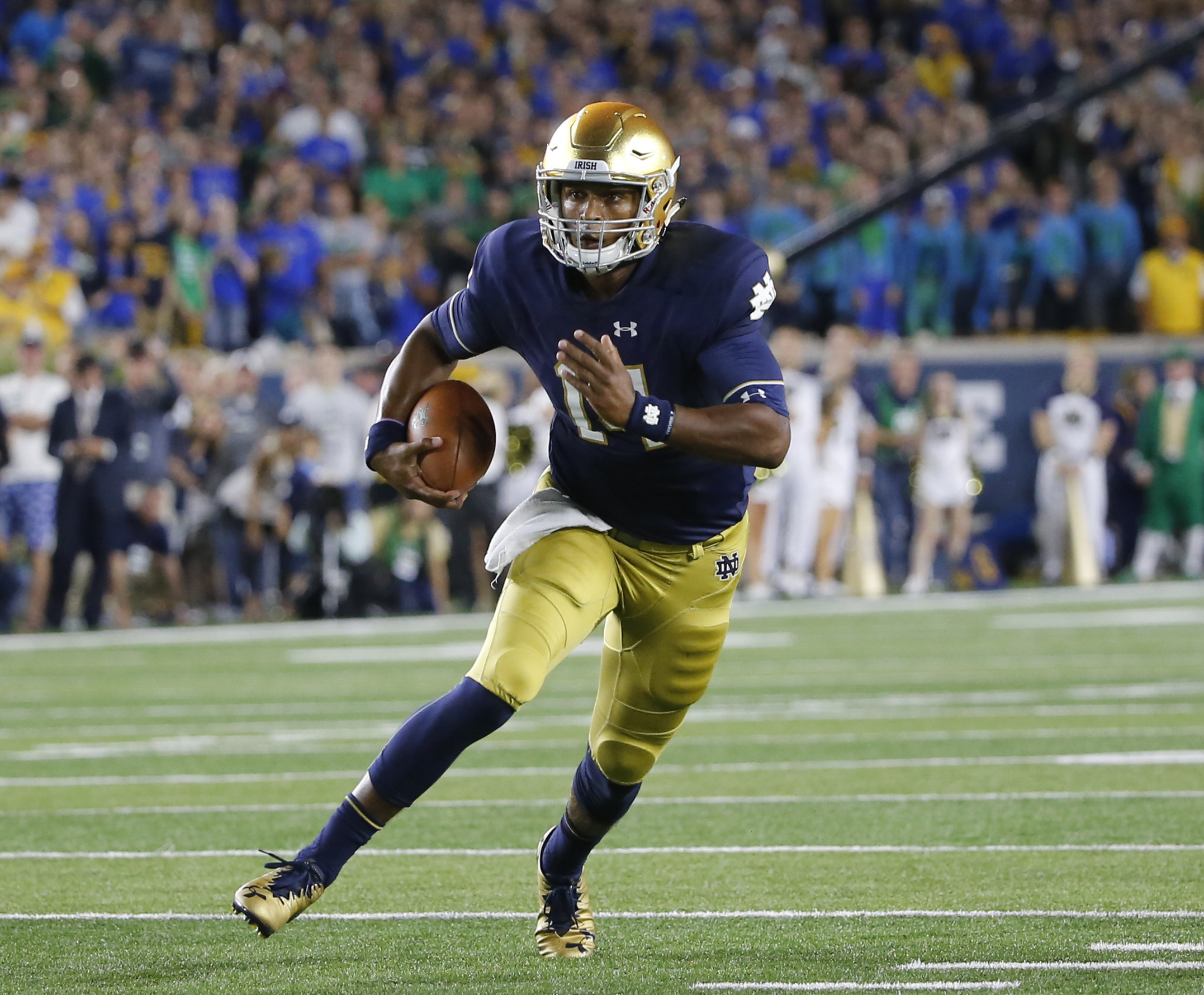 FILE - In this Sept. 17, 2016, file photo, Notre Dame quarterback DeShone Kizer (14) scrambles during the first half of an NCAA college football game against Michigan State, in South Bend, Ind. Notre Dame coach Brian Kelly isnt concerned that DeShone Kize