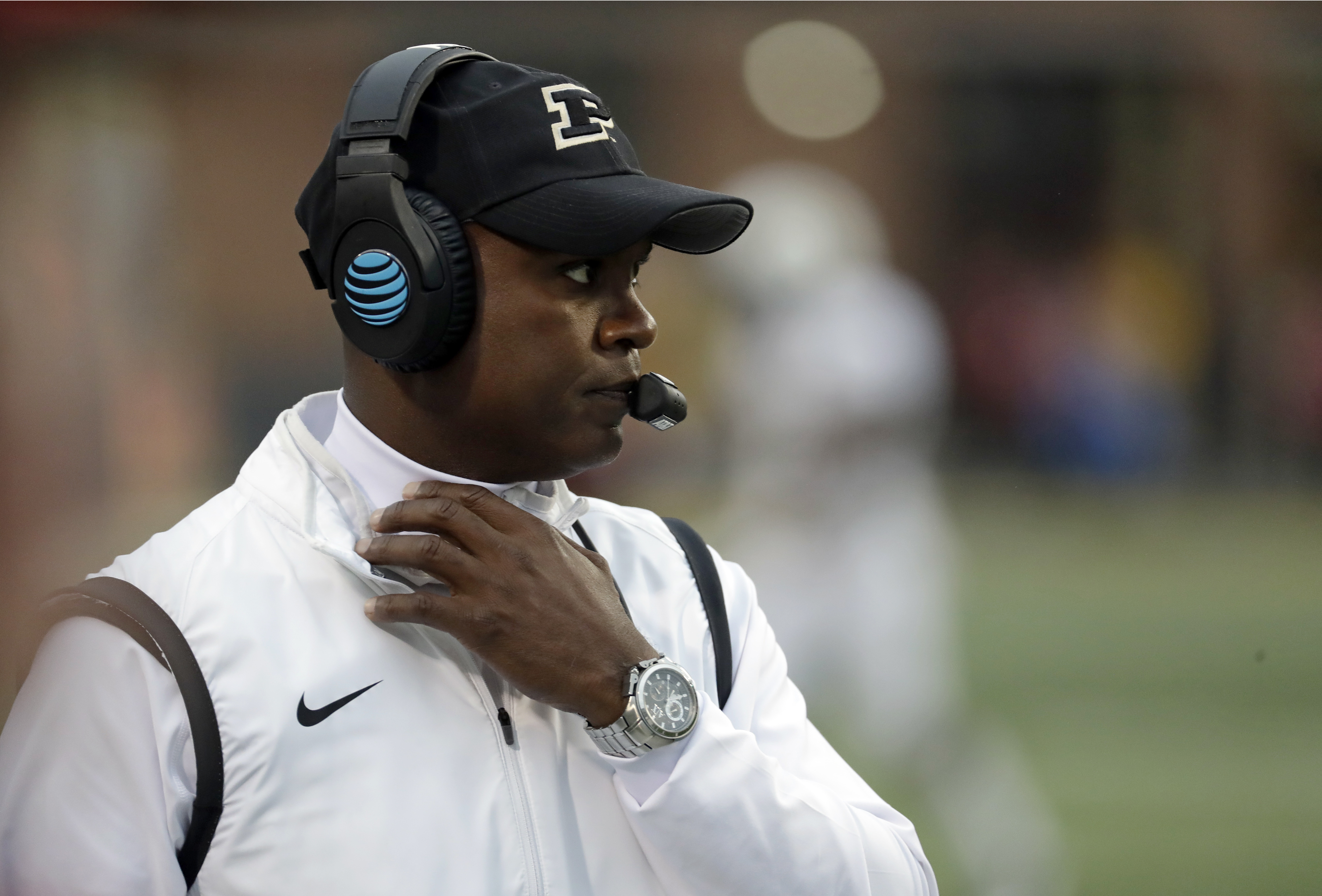 FILE - In this Oct. 1, 2016, file photo, Purdue head coach Darrell Hazell walks on the field in the second half of an NCAA college football game against Maryland in College Park, Md. Purdue coach Darrell Hazell keeps talking about his improved team. But a