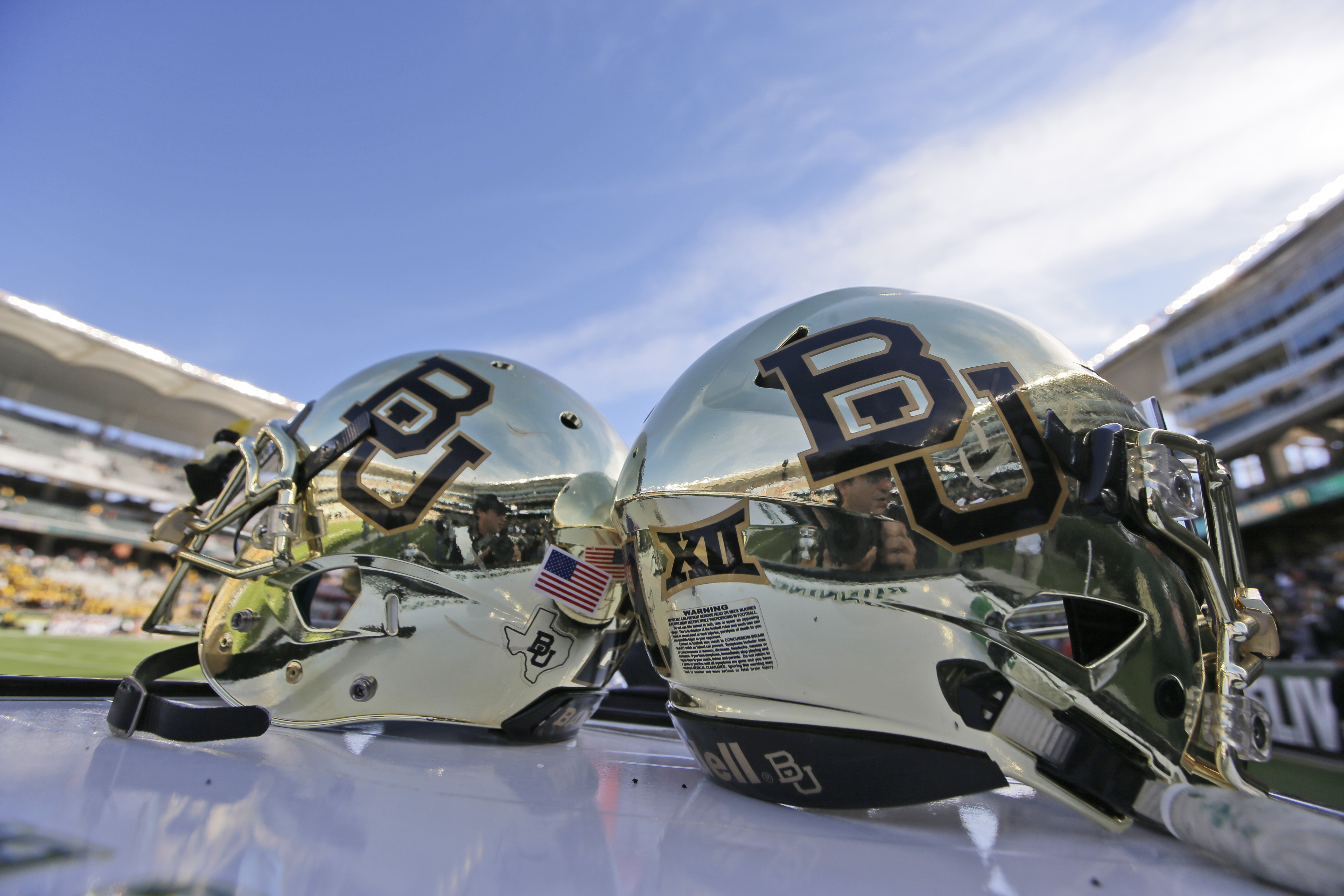 FILE - In this Dec. 5, 2015, file photo, Baylor helmets on shown the field after an NCAA college football game in Waco, Texas. Baylor University will look to rebuild its reputation and perhaps its football program after an outside review found administrat